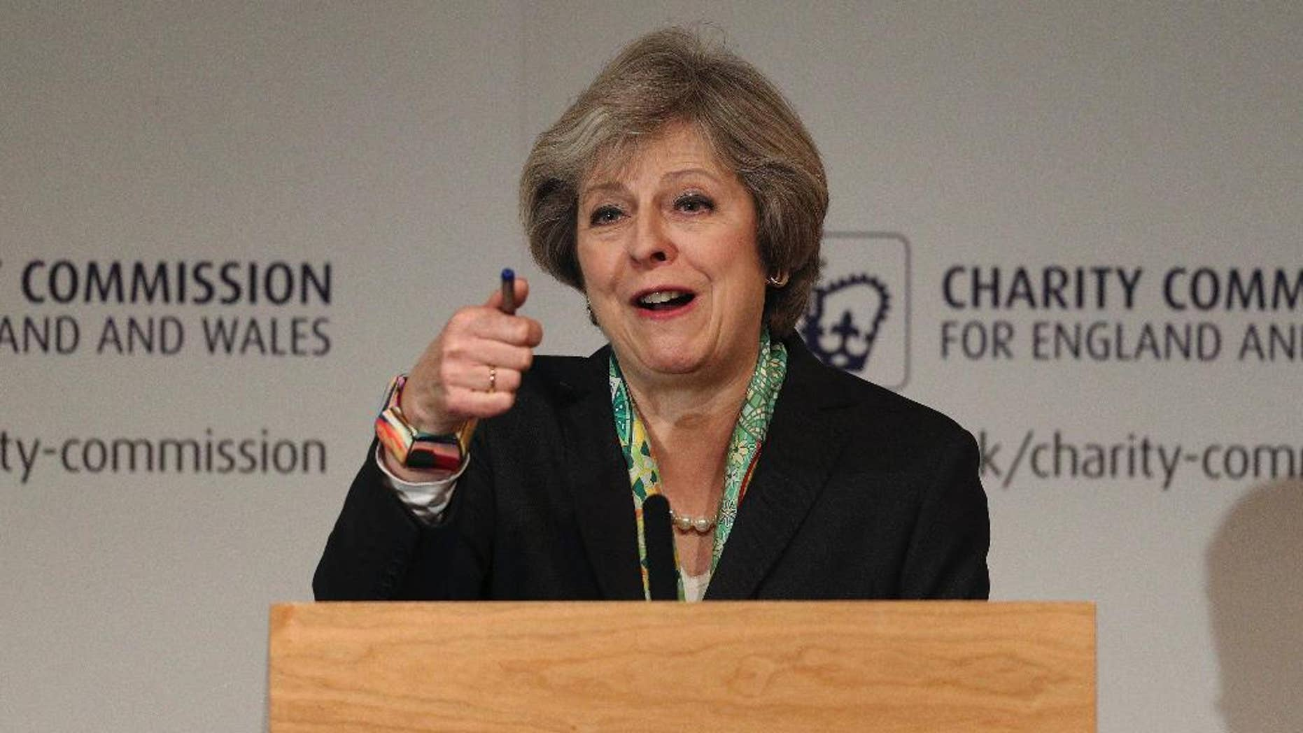 Britain's Prime Minister Theresa May speaks to members of the Charity Commission for England and Wales at The Royal Society in London, where she detailed plans to provide greater support for those suffering mental health problems, Monday Jan. 9, 2017. (Dan Kitwood/Pool via AP)
