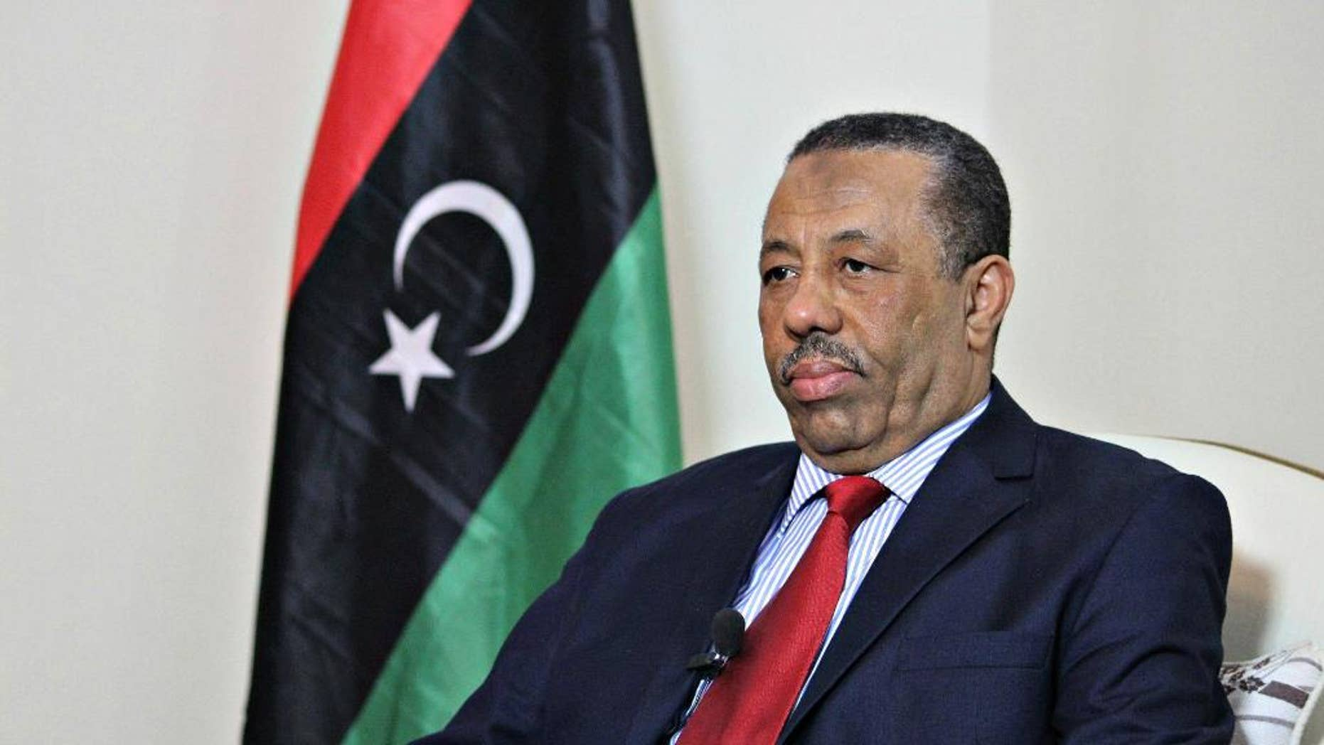 In this Wednesday, Aug. 19, 2015 photo, Prime Minister Abdullah al-Thinni listens to a question during an interview with the Associated Press in Bayda, Libya. Libya's internationally-recognized prime minister said Wednesday wants allied countries to carry out airstrikes against local Islamic State affiliates but does not want foreign ground troops, Arab or otherwise. (AP Photo/Ali Al-Shaary)