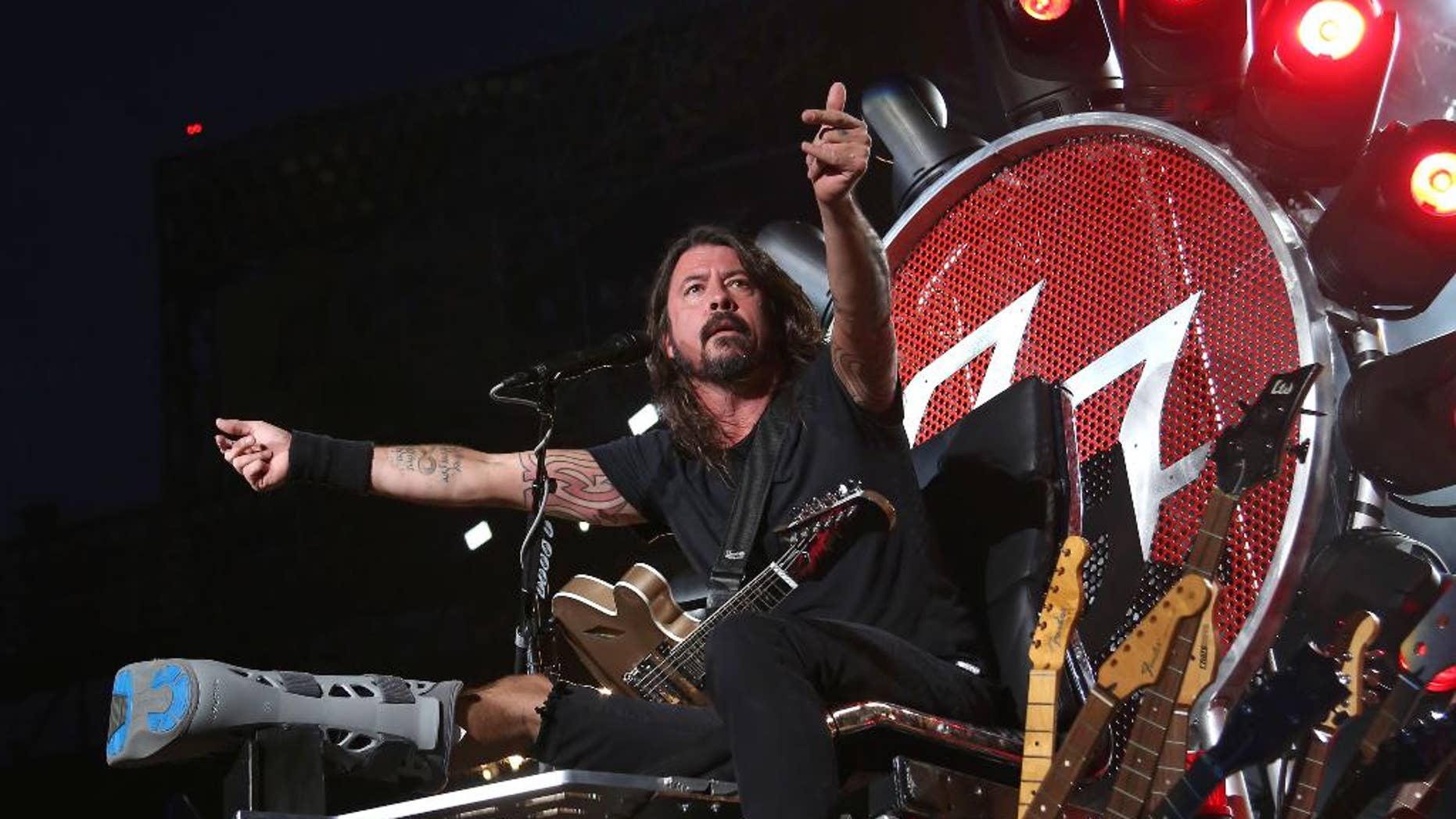 FILE - In this July 15, 2015 file photo, Dave Grohl of the Foo Fighters performs at Citi Field in New York. The band is suing insurers for failing to reimburse them for European shows they canceled following the Paris terrorist attacks in November. (Photo by Greg Allen/Invision/AP, File)