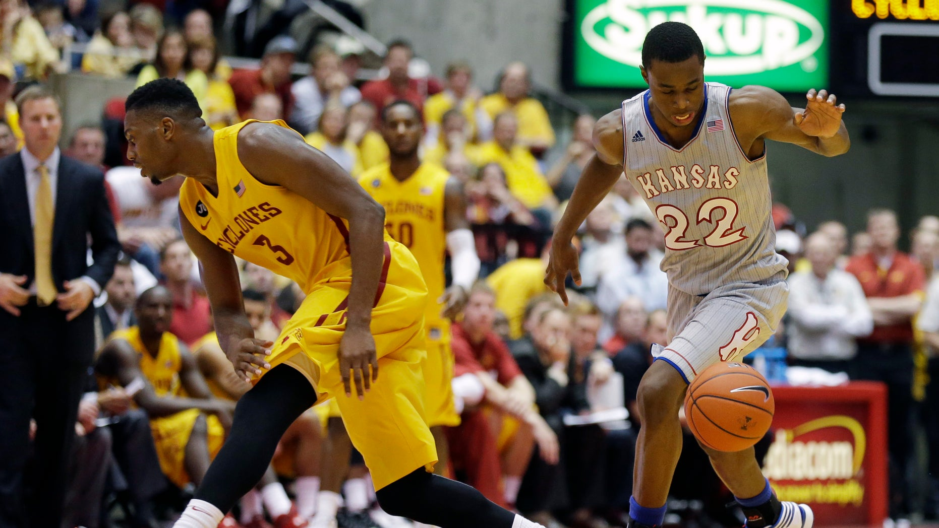 Kansas guard Andrew Wiggins, right, drives past Iowa State forward Melvin Ejim during the second half of an NCAA college basketball game, Monday, Jan. 13, 2014, in Ames, Iowa. Kansas won 77-70. (AP Photo/Charlie Neibergall)