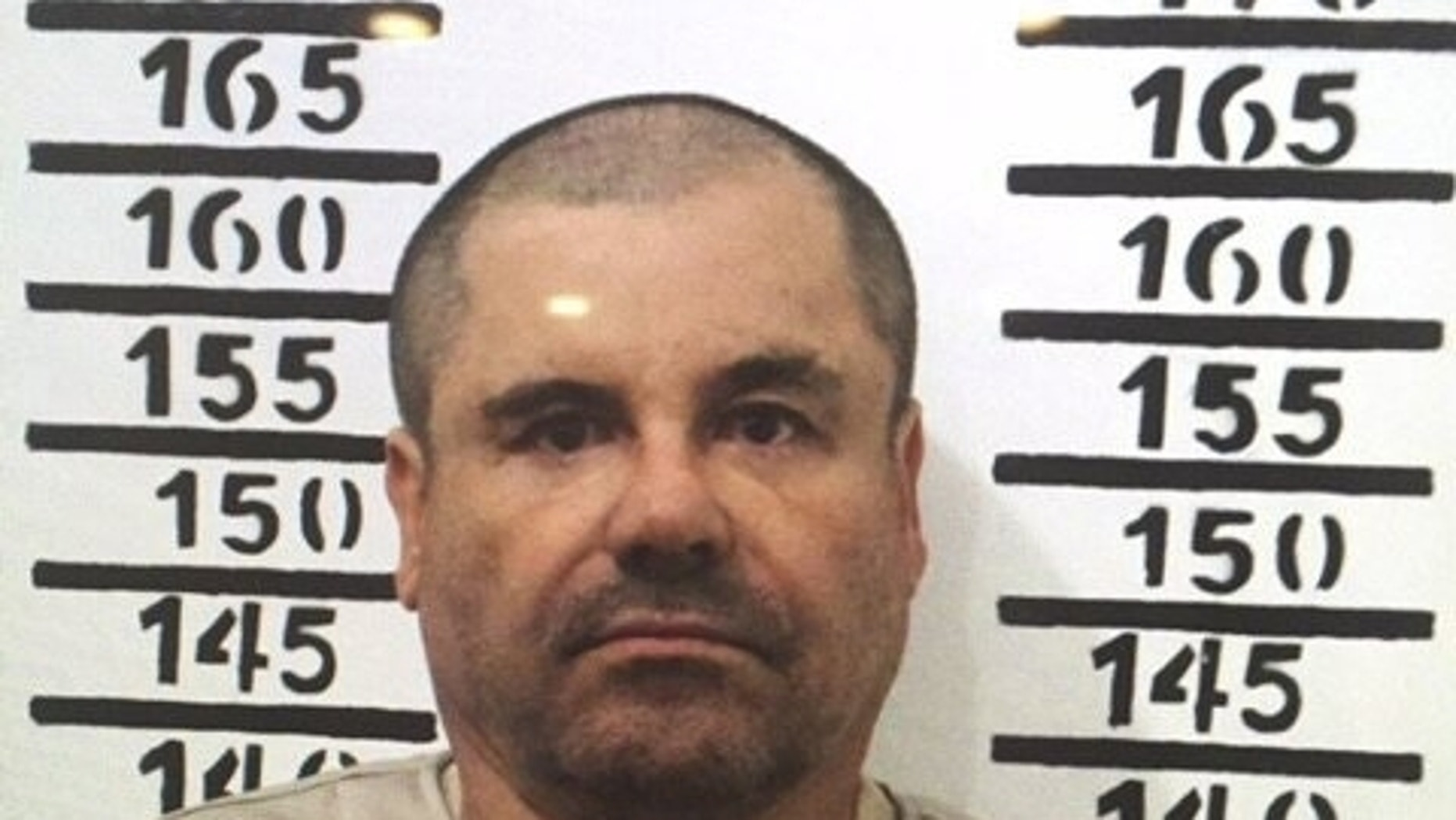 """FILE - In this Jan. 8, 2016 file photo released by Mexico's federal government, Mexico's drug lord Joaquin """"El Chapo"""" Guzman stands for his prison mug shot with the inmate number 3870 at the Altiplano maximum security federal prison in Almoloya, Mexico. According to Mexico's Foreign Ministry, Guzman was extradited to the United States on Thursday, Jan. 19 2017. (Mexico's federal government via AP, File)"""
