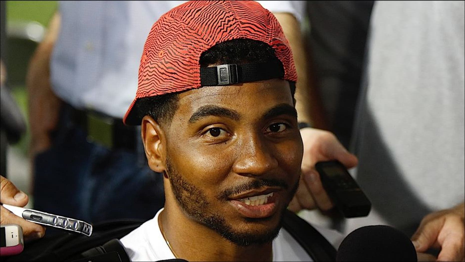 Former Ohio State quarterback turned wide receiver Braxton Miller speaks to reporters during the university's NCAA college football media day in Columbus, Ohio, Sunday, Aug. 16, 2015. (AP Photo/Paul Vernon)