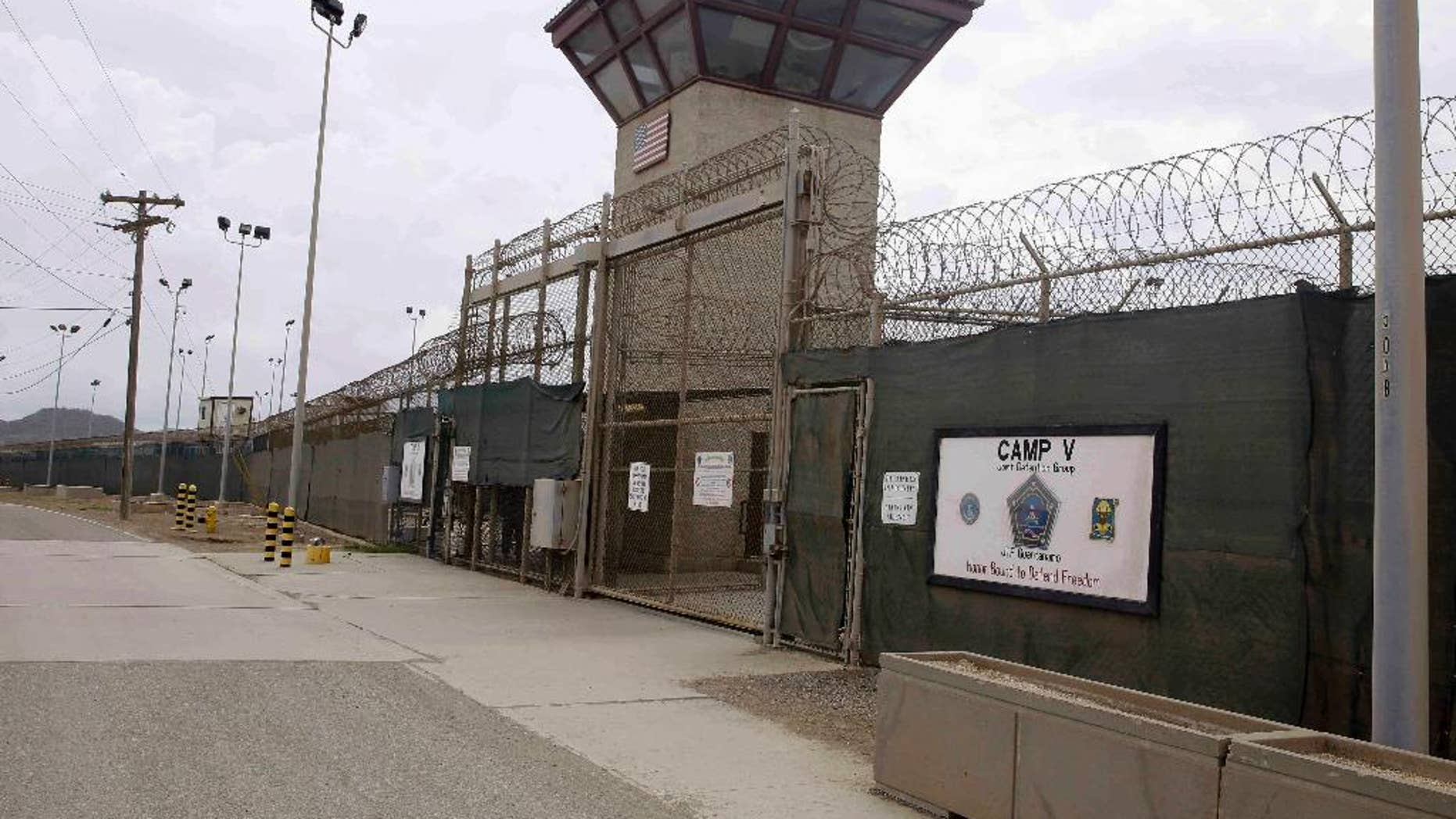 FILE - In this June 7, 2014, file photo, the entrance to Camp 5 and Camp 6 at the U.S. military's Guantanamo Bay detention center, at Guantanamo Bay Naval Base, Cuba. Oman's Foreign Ministry said in a statement Monday, Jan. 16, 2017, it accepted 10 inmates from the U.S. prison at Guantanamo Bay ahead of U.S. President Barack Obama leaving office, part of his efforts to shrink the facility he promised to close. There was no immediate word from the U.S. Defense Department about the transfer. (AP Photo/Ben Fox, File)
