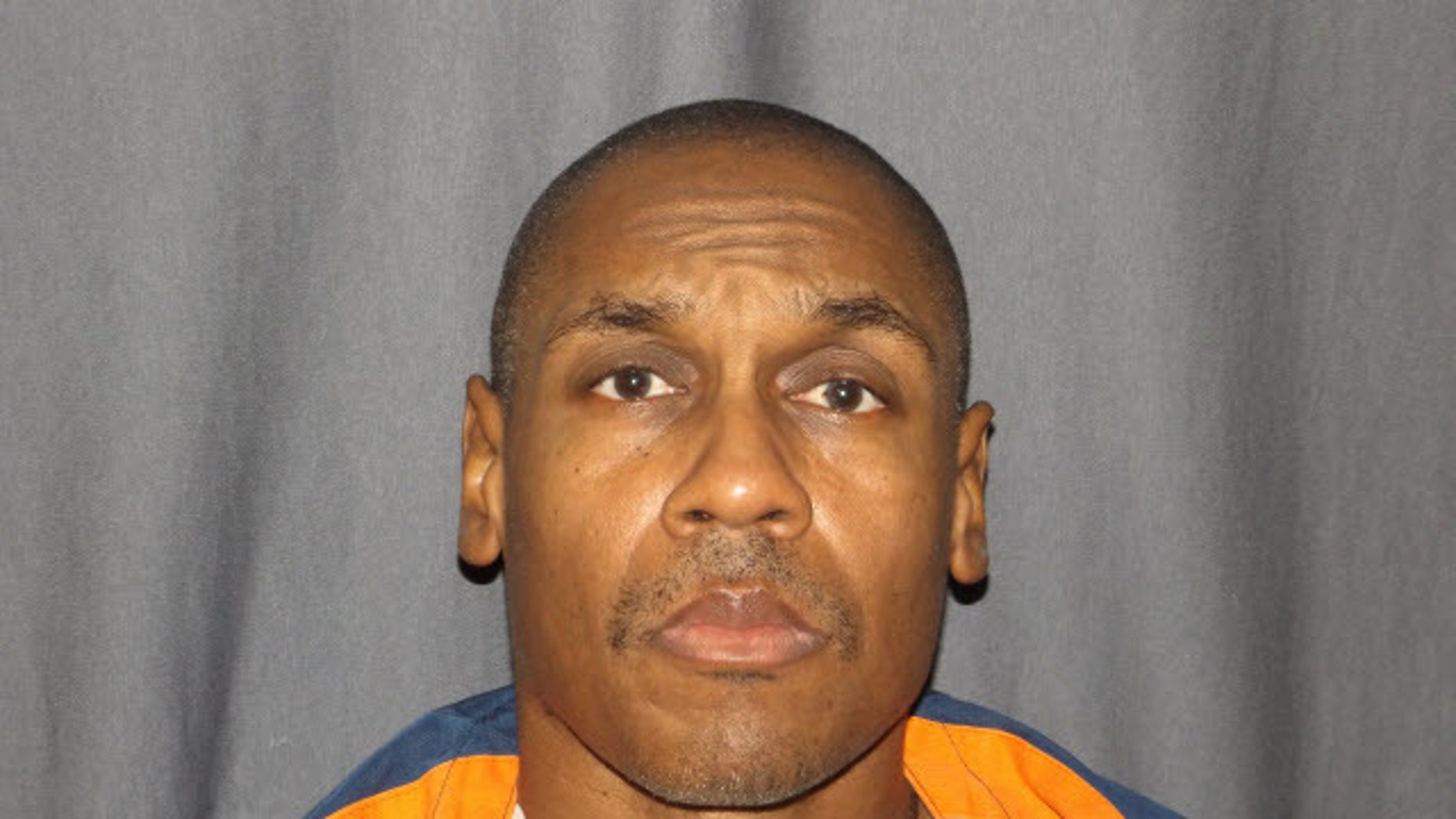 In this undated photo provided by the Michigan Department of Corrections shows Michael Darnell Harris. Ingham County Circuit Court set a Sept. 23, 2016, hearing to consider new evidence that could overturn the conviction of Harris in the slaying of Ula Curdy, the Detroit Free Press reported. Harris is serving life sentences for killing Curdy as well as multiple other women. (Michigan Department of Corrections via AP)