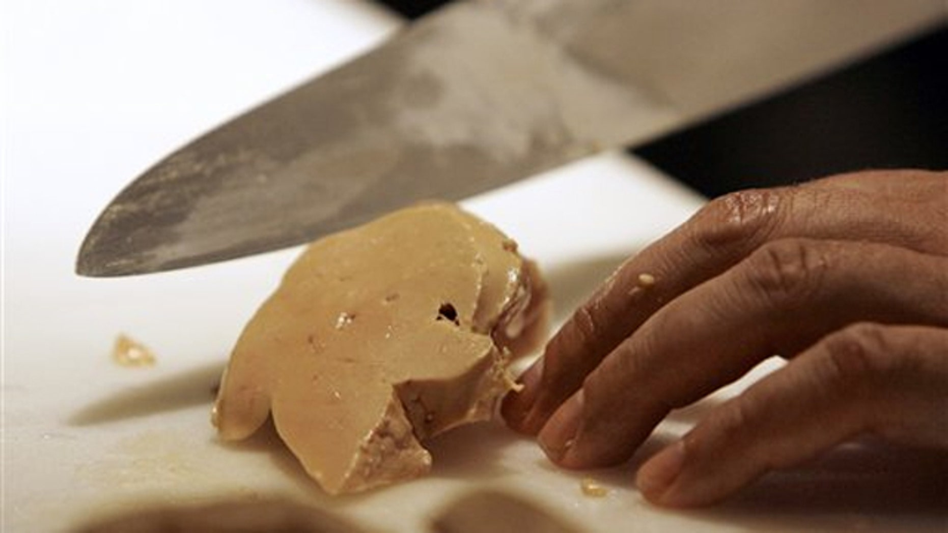 Todd Stein, the executive chef at MK in Chicago, slices a piece of foie gras.