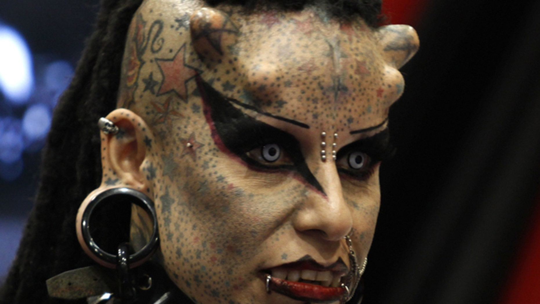 """Mexican tattoo artist Maria Jose Cristerna, known as 'Mujer Vampiro' (Vampire Woman), attends a photo opportunity during the """"Expo Tatuaje"""" international tattoo expo in Monterrey April 3, 2011."""