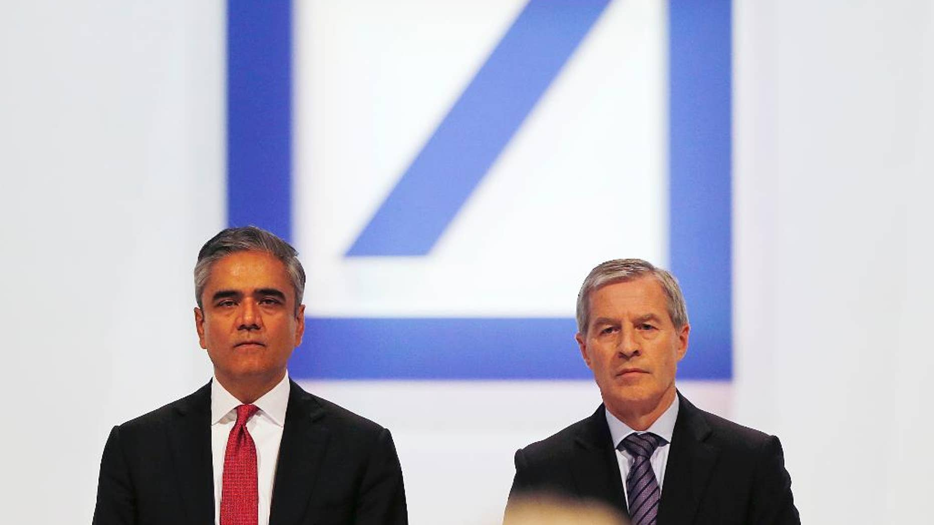 FILE - In this May 22, 2014 file photo Co-CEOs of Deutsche Bank Anshu Jain, left, and Juergen Fitschen pose for photographers during the annual shareholders meeting in Frankfurt, Germany. Deutsche Bank said Sunday, June 7, 2015 that Jain and Fitschen will resign.  John Cryan will succeed Jain in July 2015 and will become the sole CEO in May 2016.  (AP Photo/Michael Probst, file)