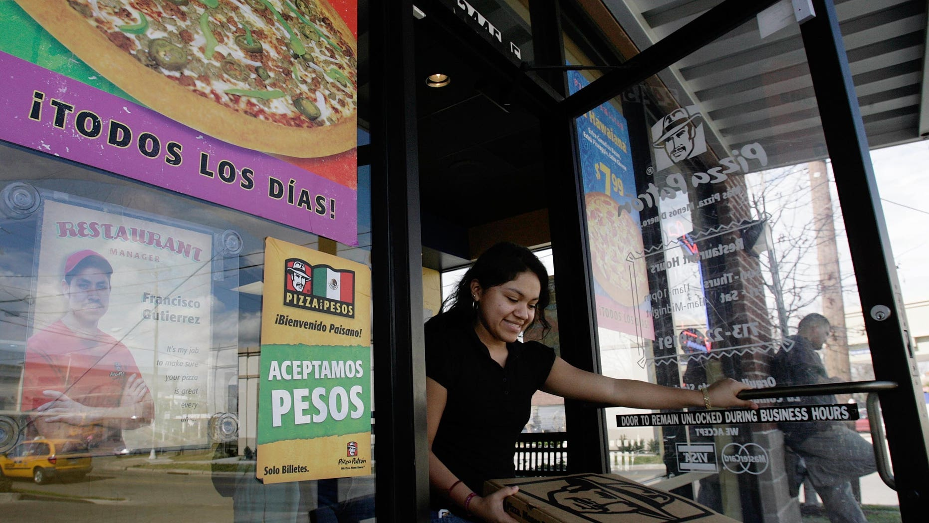 HOUSTON, TX - JANUARY 12:  A customer leaves a Pizza Patron January 12, 2007, in Houston. The pizza chain now accepts Mexican pesos and U.S. dollars as payment.  (Photo by Dave Einsel/Getty Images)