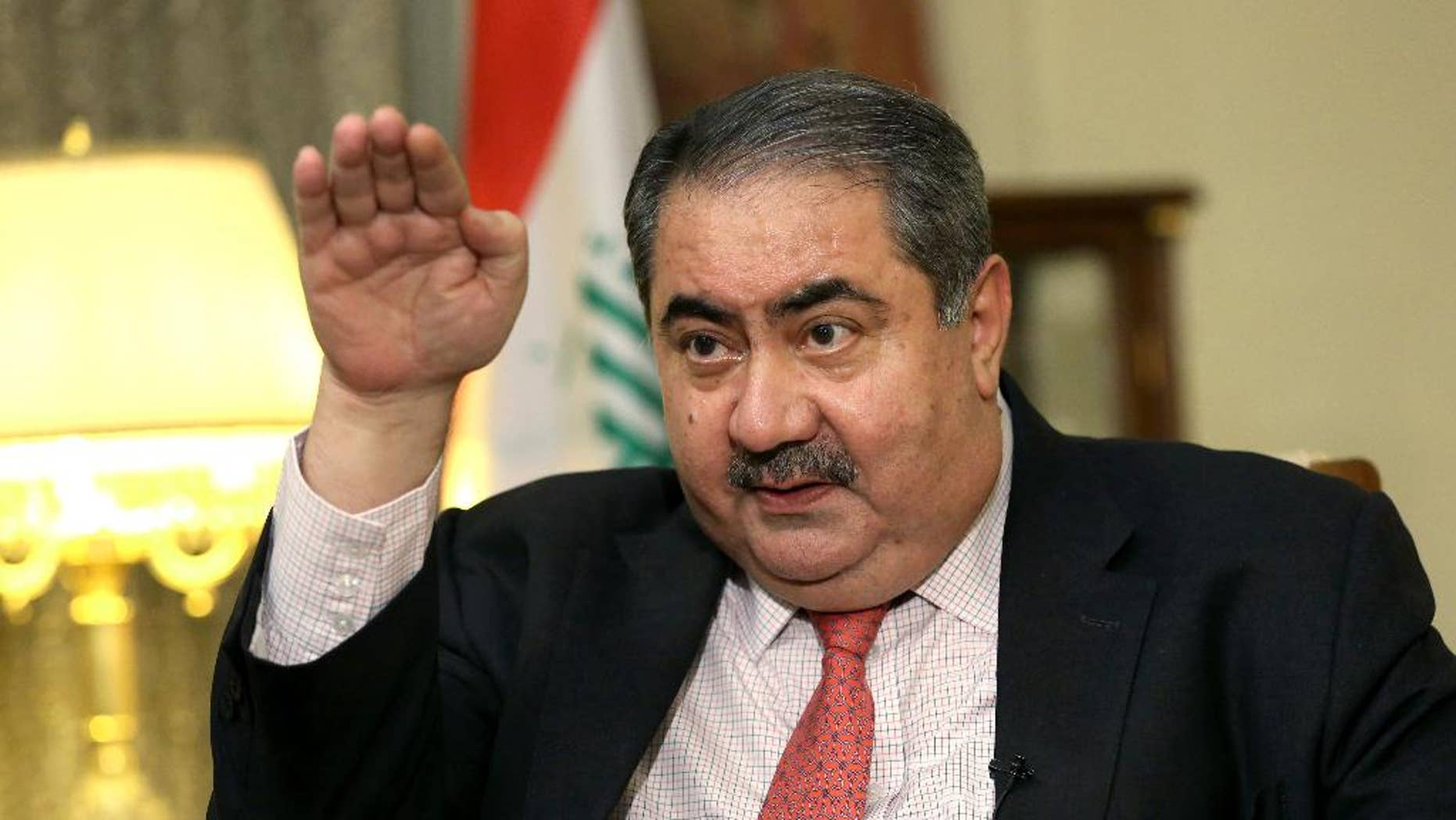 FILE - In this Dec 3, 2014 file photo, Iraq's Finance Minister Hoshyar Zebari speaks during an interview with the Associated Press in Baghdad, Iraq. Iraq's parliament has dismissed the finance minister after a no-confidence vote linked to allegations of corruption and mismanagement. The removal of Zebari, a former foreign minister and prominent Kurdish politician who has denied any wrongdoing, comes as Iraq is grappling with an economic crisis driven by low oil prices and the costs of battling the Islamic State group. (AP Photo/Hadi Mizban, File)