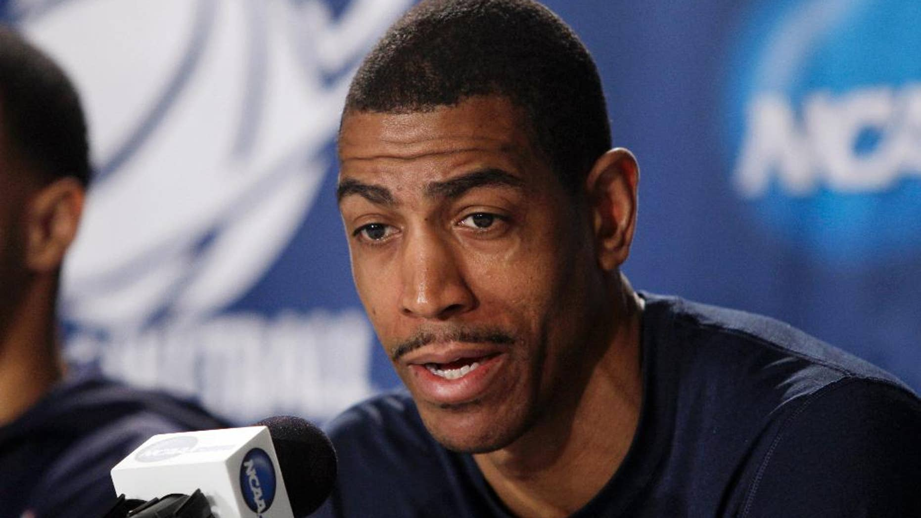 Connecticut head coach Kevin Ollie responds to a question during a news conference at the NCAA college basketball tournament  Saturday, March 29, 2014, in New York. Connecticut plays Michigan State in a regional final on Sunday. (AP Photo/Frank Franklin II)
