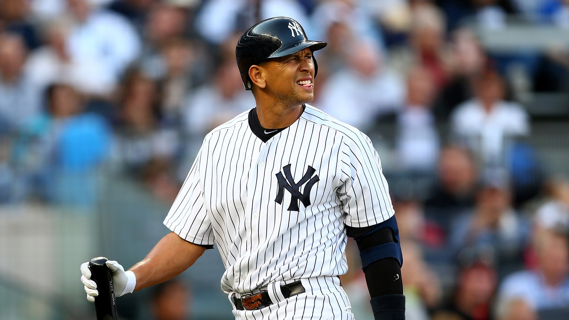 NEW YORK, NY - OCTOBER 14:  Alex Rodriguez #13 of the New York Yankees reacts as he walks back to the dugout after he struck out in the bottom of the second inning against the Detroit Tigers during Game Two of the American League Championship Series at Yankee Stadium on October 14, 2012 in the Bronx borough of New York City.  (Photo by Elsa/Getty Images)