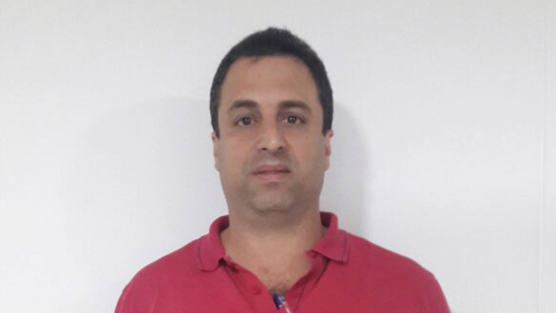 This photo released by Colombia's National Police shows Panama businessman Nidal Waked after he was arrested at the international airport in Bogota, Colombia, Wednesday, May 4, 2016. Waked is sought by the United States and accused of being a leader of an organization that laundered drug profits through a web of companies including a luxury mall, a bank and the duty-free zone at Panama City's international airport. (Colombia National Police via AP)