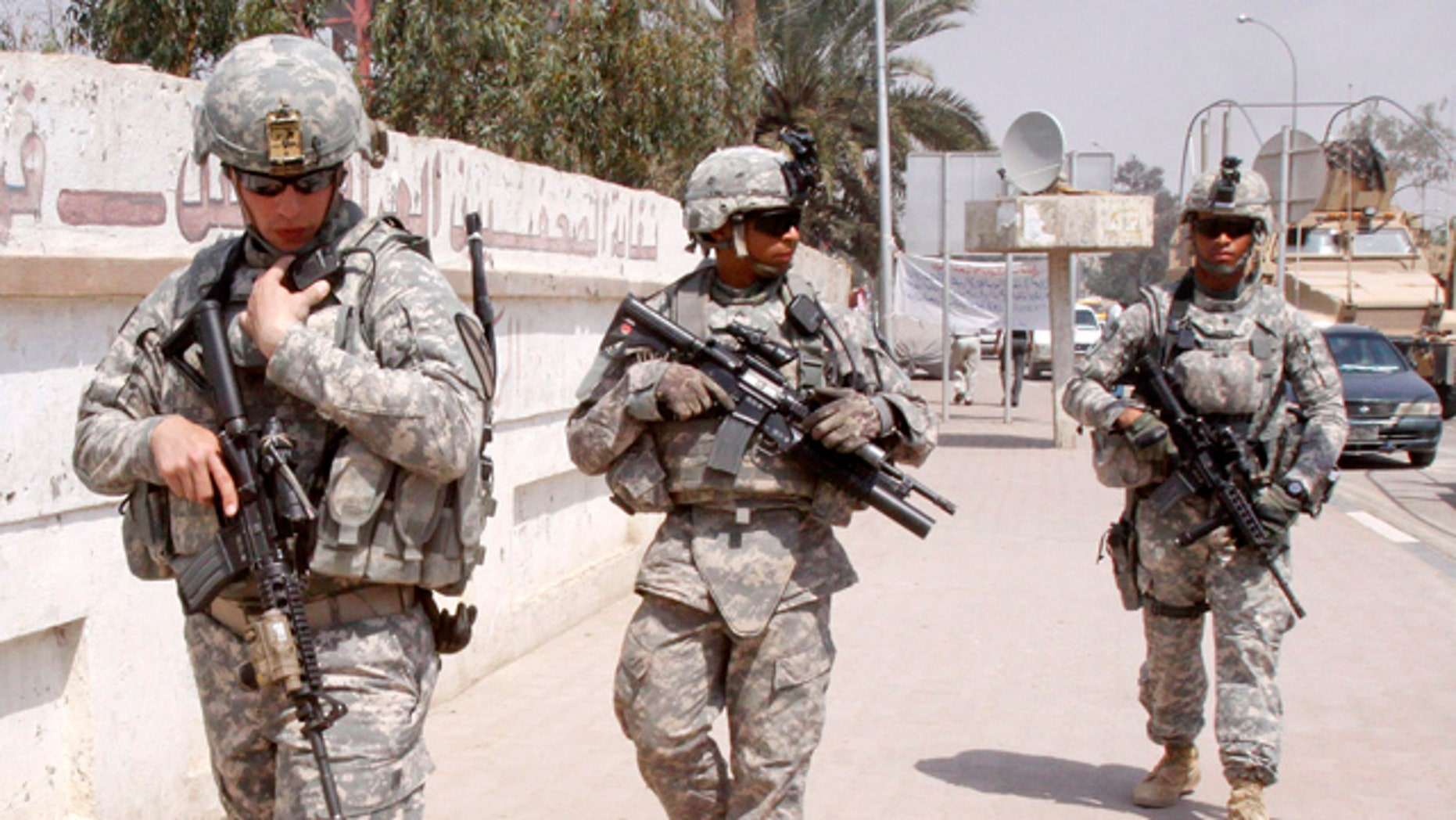 March 23, 2011: U.S. troops stand guard outside a local journalists' union office in Basra, Iraq.
