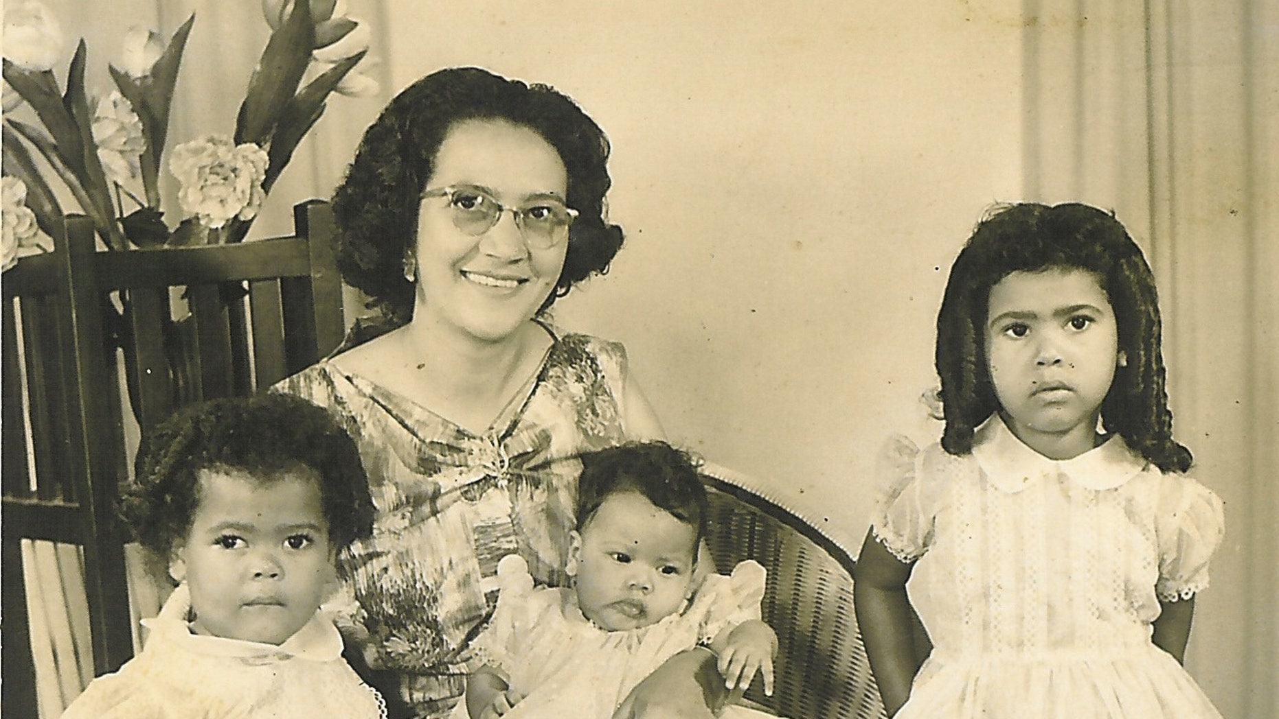 In this undated photo courtesy of Michelle Faul, Ethel Pillay is shown with her daughters, from left,  Carole, Danette and Michelle, who experienced South Africa's apartheid system when they traveled there to visit relatives.  Associated Press Chief Africa Correspondent Michelle Faul described how on one trip, after a 15-hour drive, a gas station refused to hand over the keys to the toilet to her mother because it was for whites only. Nelson Mandela fought to bring down the institutionalized code that  made blacks subhuman.  (AP Photo/Courtesy of Michelle Faul)