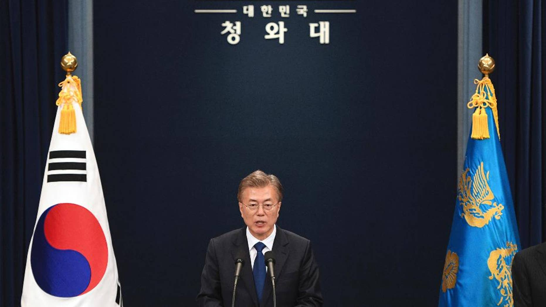 In this May 10, 2017, file photo, South Korea's new President Moon Jae-In speaks at the presidential Blue House in Seoul. Addressing the nation after taking the oath of office on Wednesday, May 10, 2017, South Korean President Moon Jae-in vowed to eventually move out of the Blue House, where every modern South Korean president has lived and worked since the end of World War II. (JungJ Yeon-Je/Pool Photo via AP, File)
