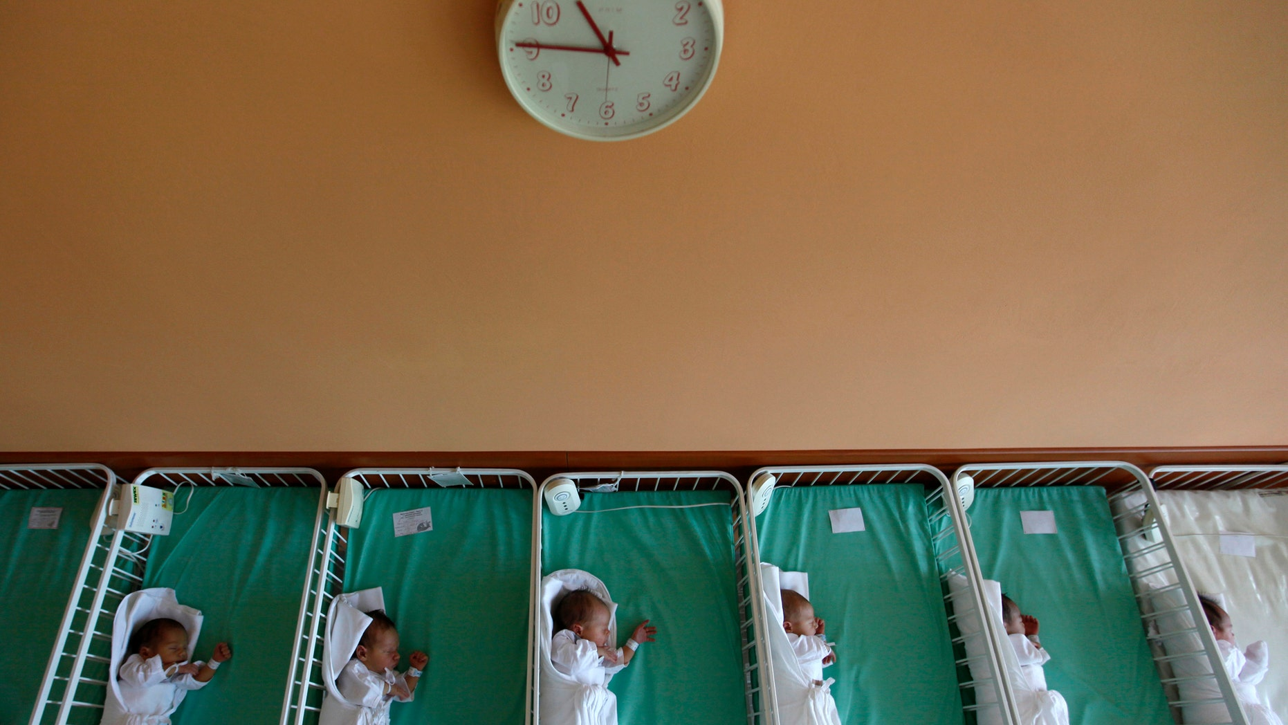 File photo - Newborn babies rest in cots in Kosice, east Slovakia May 25, 2011. (REUTERS/Petr Josek)