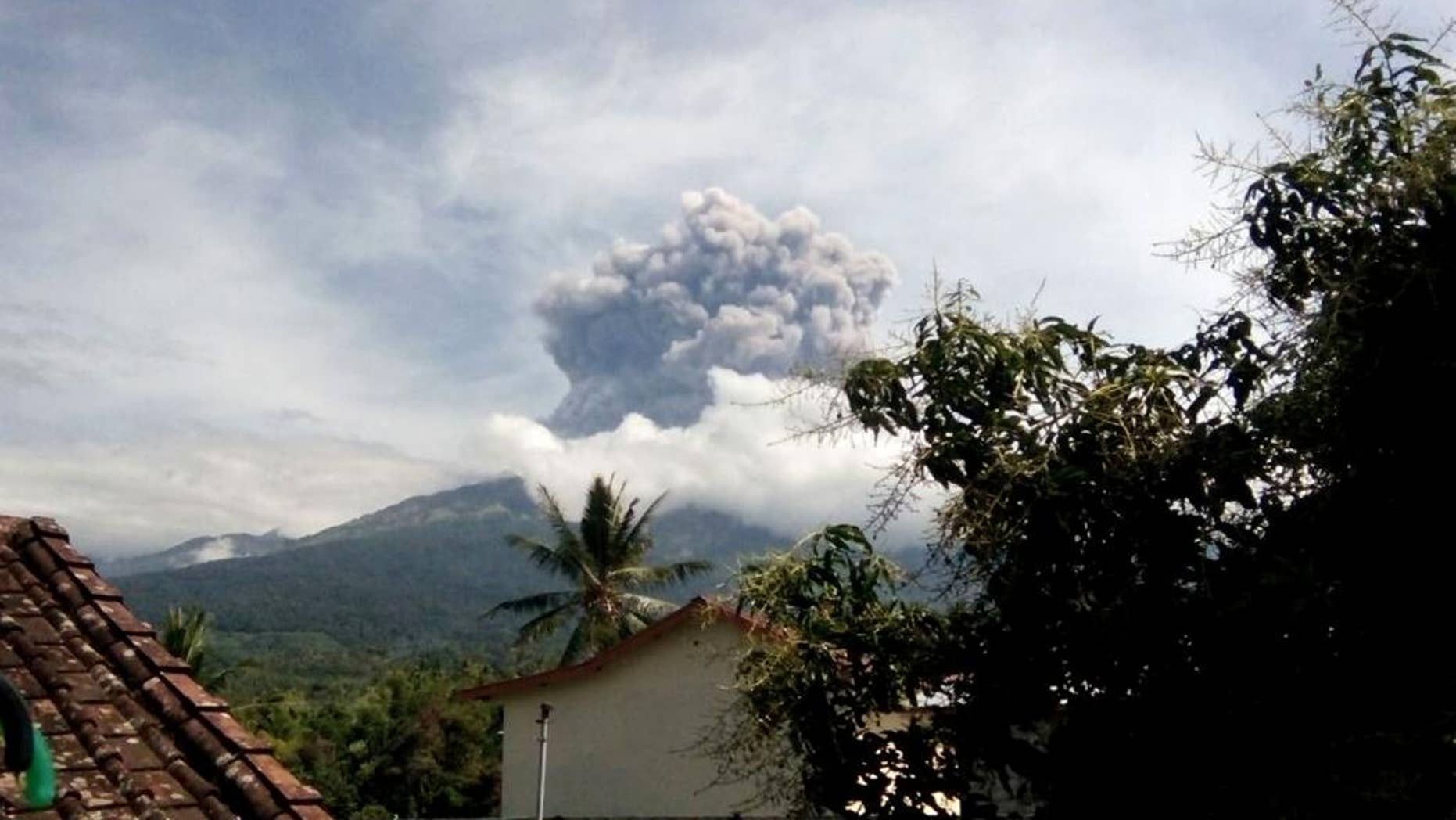 In this Tuesday, Sept. 27, 2016 photo, volcanic material from the eruption of Mount Barujari is seen from Bayan, Lombok Island, Indonesia. The volcano erupted without warning on Tuesday afternoon, delaying flights from airports on the islands of Lombok and Bali. (AP Photo/Denda Wiyana Putri)