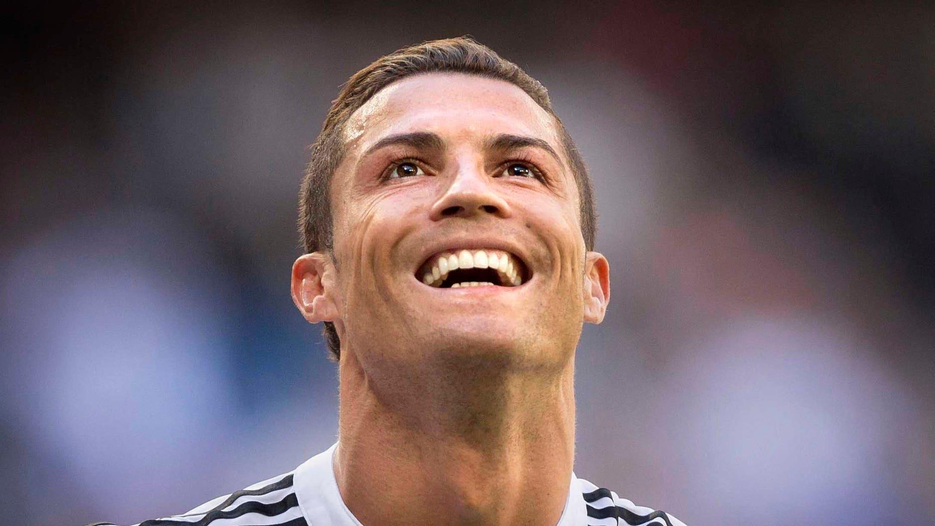 Real Madrid's Cristiano Ronaldo celebrates after scoring a goal during a La Liga soccer match between Real Madrid and Granada at the Santiago Bernabeu stadium in Madrid, Spain, Sunday, April 5, 2015. (AP Photo/Daniel Ochoa de Olza)