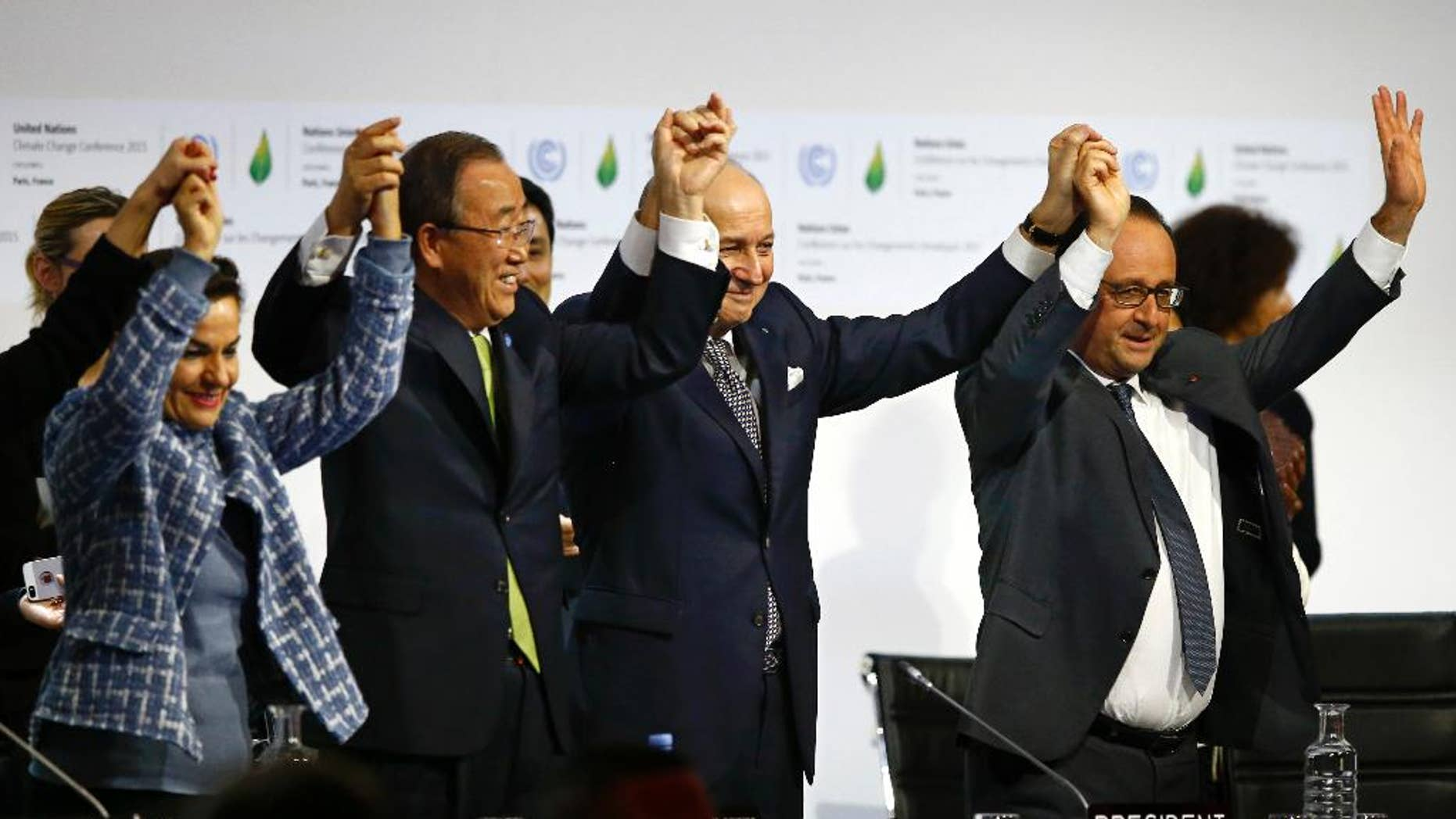 FILE - In this Dec. 12, 2015, file photo, French President Francois Hollande, right, French Foreign Minister and president of the COP21 Laurent Fabius, second right, United Nations climate chief Christiana Figueres, left, and United Nations Secretary General Ban Ki-moon hold their hands up in celebration after the final conference at the COP21, the United Nations conference on climate change, in Le Bourget, north of Paris. A team of top scientists are telling world leaders to stop congratulating themselves for a Paris agreement to fight climate change because if more isn't done the world will likely hit the agreed-upon dangerous warming level in about 35 years.  (AP Photo/Francois Mori, File)