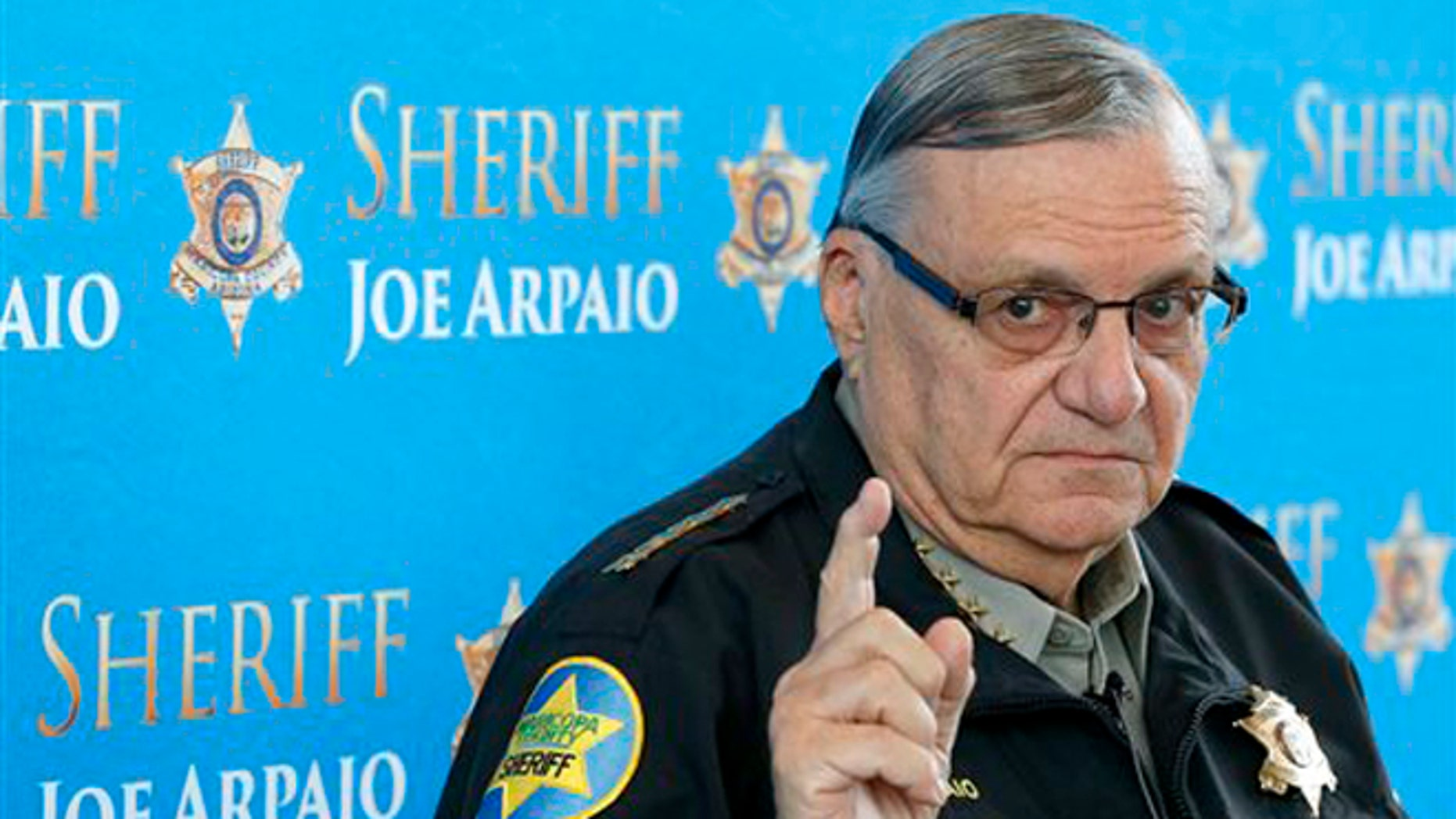 FILE - In this Dec. 18, 2013 file photo, Maricopa County Sheriff Joe Arpaio pauses as he answers a question at a news conference at Maricopa County Sheriff's Office Headquarters, in Phoenix.  A judge presiding over a racial profiling case against Arpaio's office is holding a hearing Wednesday, May 7, 2014, to examine whether people working for the agency have read a summary of the case's key findings. (AP Photo/Ross D. Franklin, file)