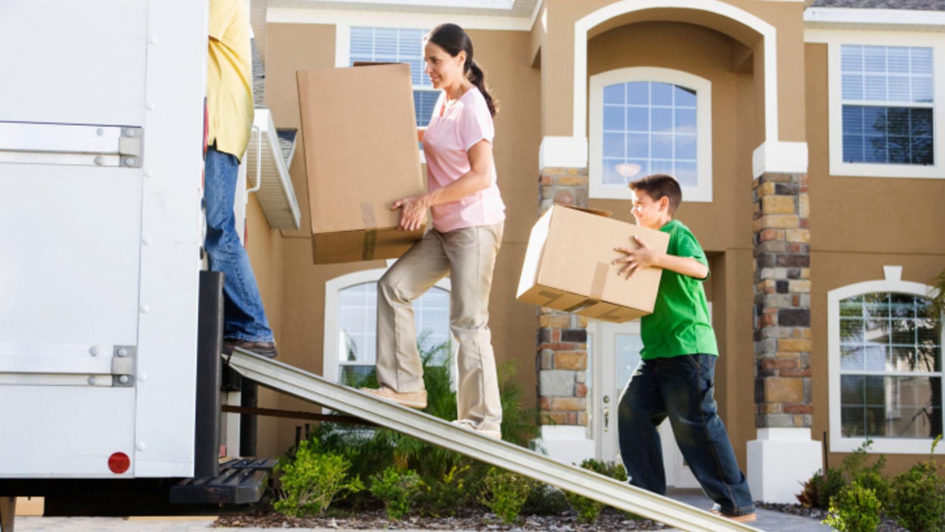 Family Loading Moving Truck