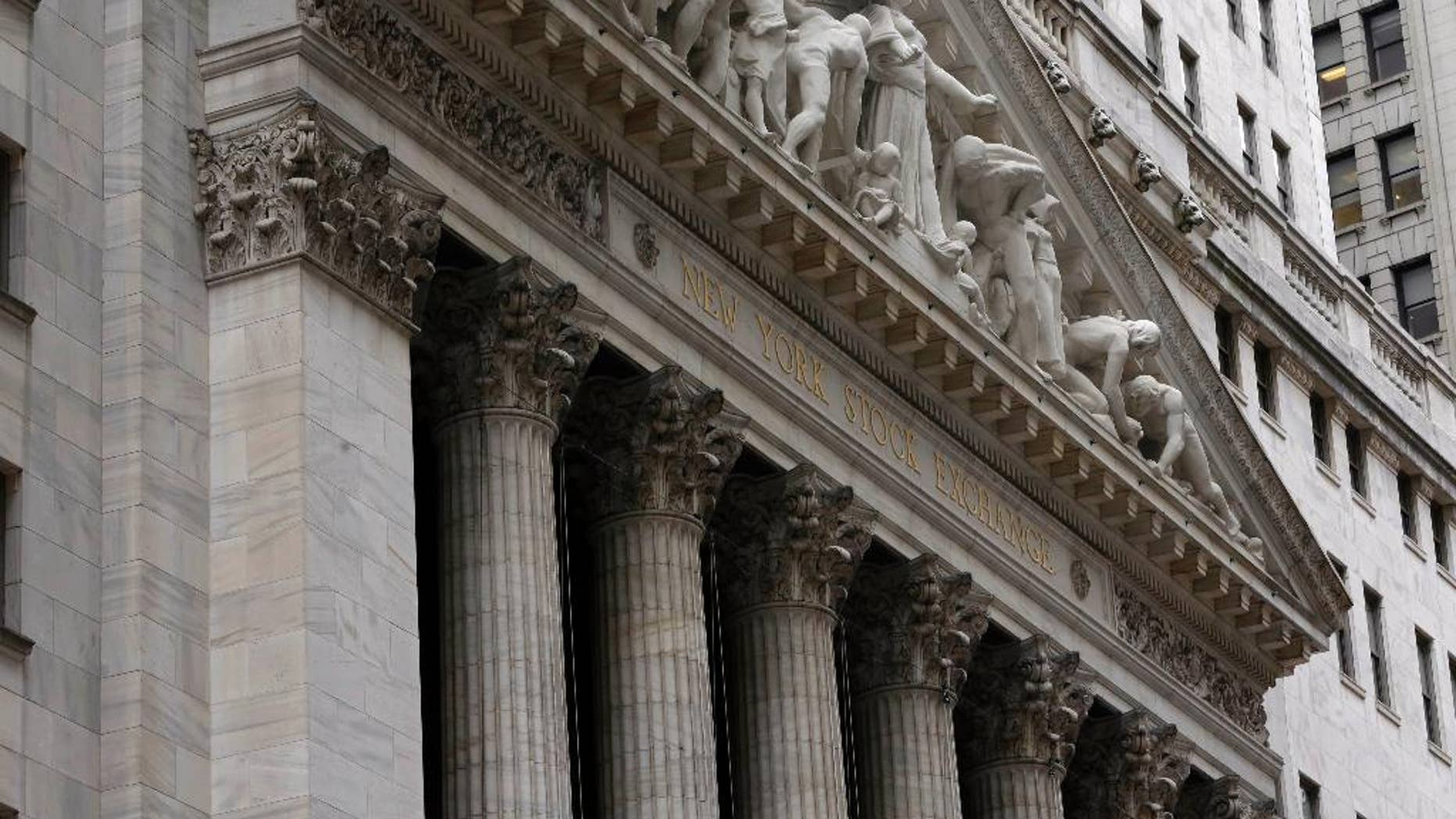 The facade of the New York Stock Exchange, Thursday, Oct. 2, 2014. Global stocks were mostly lower Wednesday Dec. 17, 2014 as oil prices tumbled again while investors waited for a U.S. Federal Reserve statement on monetary policy. (AP Photo/Richard Drew)