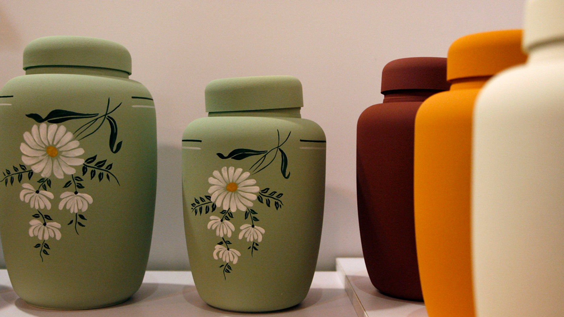 FILE: Eco-friendly cremation urns are displayed during the Asia Funeral Expo at the Macau Tower Convention center.