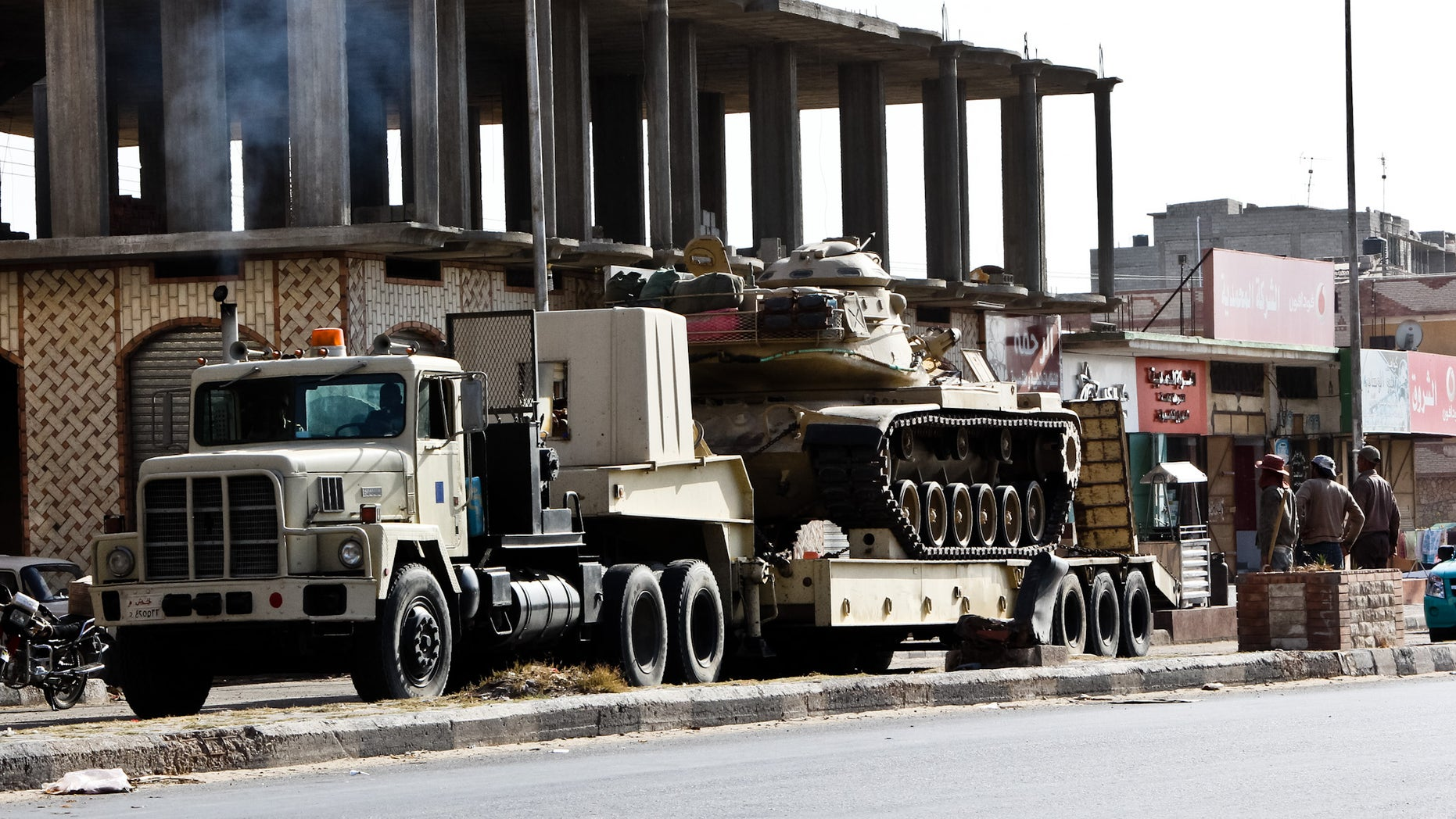 An Egyptian Army vehicle with a tank heads to the closed Rafah border crossing between Egypt and the Gaza strip, in Sheikh Zuweyid, northern Sinai, Egypt, Monday, May 20, 2013. Security officials said 17 military and more than 20 police armored vehicles were deployed in northern Sinai Monday as a response to the kidnapping by suspected militants of six policemen and a border guard there last Thursday. It was not clear if they deployed to rescue the hostages, to make a show of force to intimidate their captors, or for another reason. (AP Photo/Roger Anis, El Shorouk Newspaper) EGYPT OUT