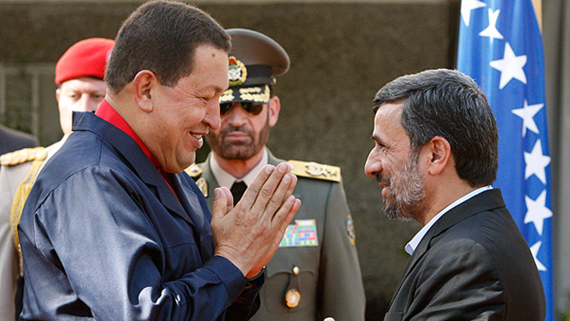 Oct. 19: Venezuelan President Hugo Chavez, left, is welcomed by his Iranian counterpart Mahmoud Ahmadinejad in Tehran.