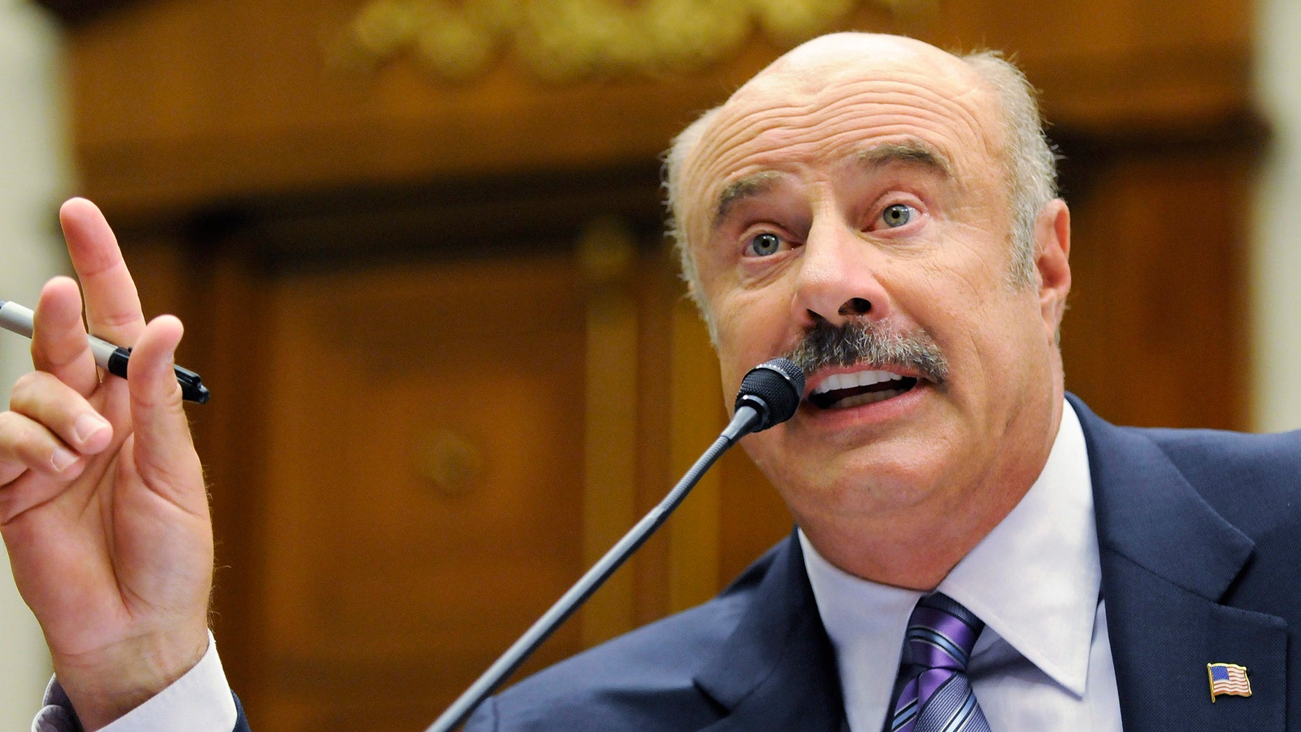 Dr. Phil McGraw, television personality and psychologist, talks about cyber-bullying during a hearing of the Healthy Families and Communities Subcommittee of the U.S. House Committee on Education and Labor, on Capitol Hill in Washington, June 24, 2010.  REUTERS/Jonathan Ernst (UNITED STATES - Tags: ENTERTAINMENT POLITICS) - RTR2FOBM