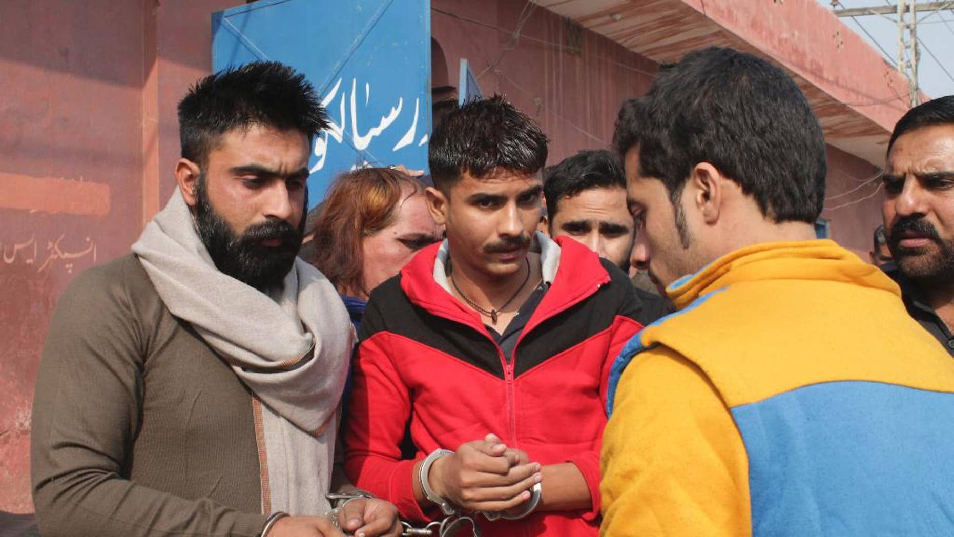 People allegedly involved in the flogging of a transgender person arrive at a court in Sialkot, Pakistan, Monday, Nov. 14, 2016. A Pakistani officer said police have arrested 10 members of a criminal gang who flogged a transgender person and posted the incident on social media. The officer said Monday's arrests were made in the eastern Pakistani city of Sialkot after a video of the flogging was shared thousands of times on social media. (AP Photo/Shahid Ikram)