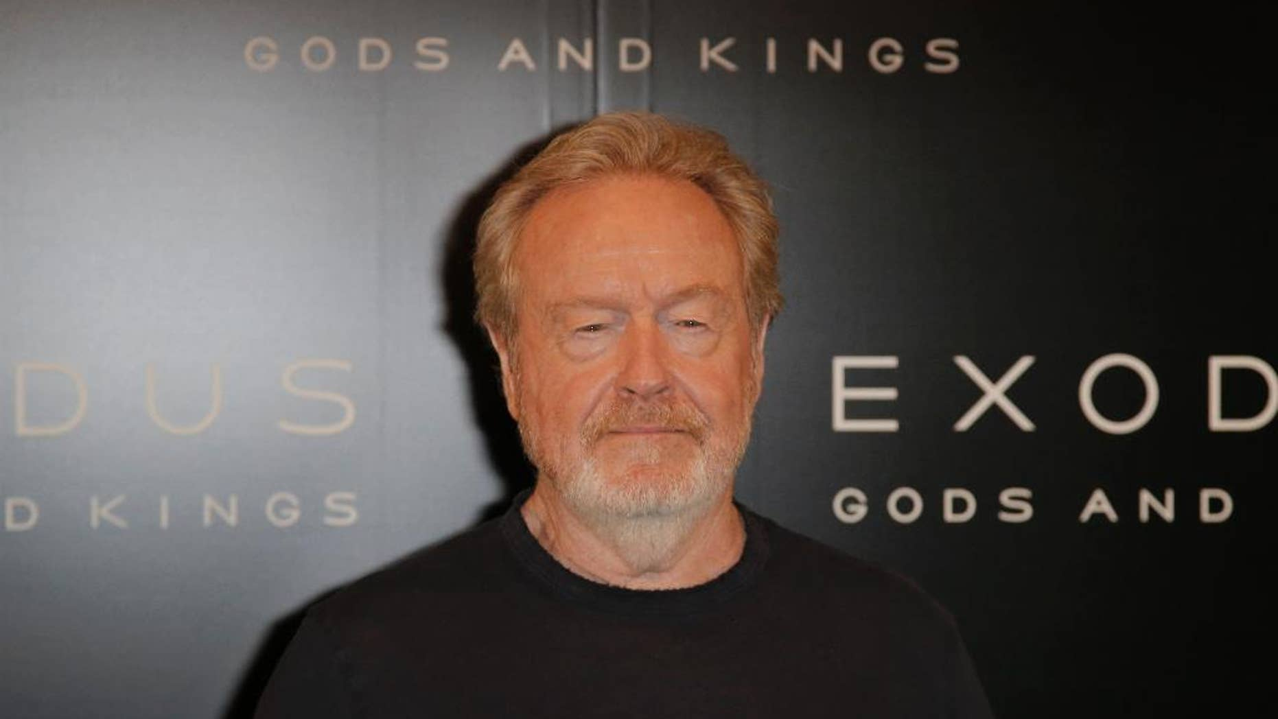 """In this Tuesday, Dec. 2, 2014 file photo, director Ridley Scott poses during a photocall for his film """"Exodus : Gods and Kings"""" in Paris. Scott did not originally want to make """"Exodus: Gods and Kings."""" """"It's biblical, and I was afraid of all those associations,"""" the 77-year-old filmmaker said. (AP Photo/Francois Mori, File)"""