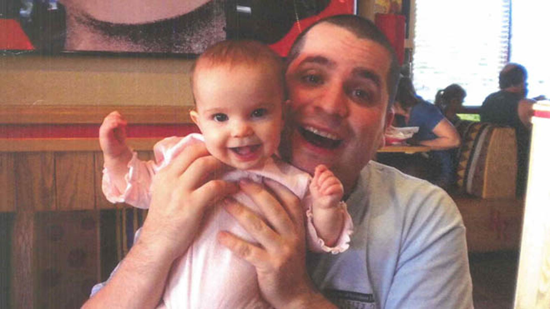 March 12, 2013: This undated file photo submitted into evidence by defense attorney Julia L. Gatto shows New York City police Officer Gilberto Valle with his daughter. Valle, accused of plotting to kidnap, cook and eat women _ including his wife _ was convicted of conspiracy.