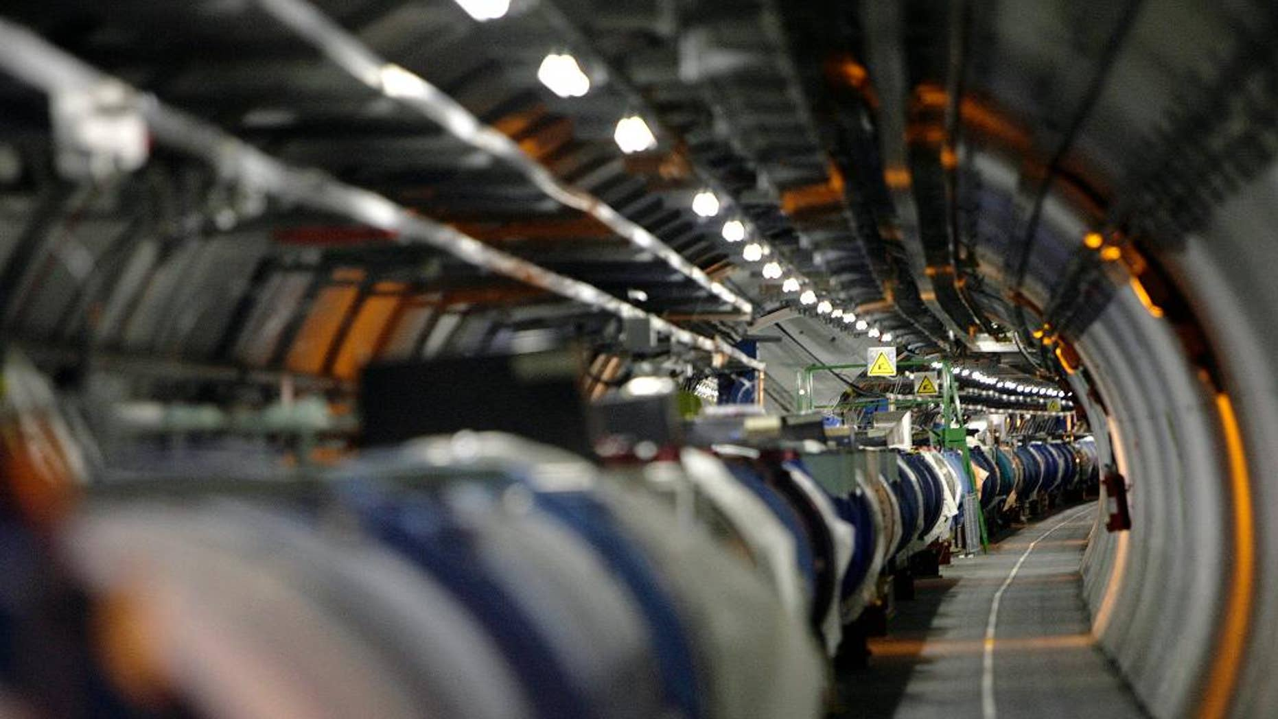 FILE - A May 31, 2007 file photo shows a view of the Large Hadron Collider in its tunnel at the European Particle Physics Laboratory, CERN, near Geneva, Switzerland. It's one of the physics world's most complex machines, and it has been immobilized — temporarily — by a weasel. Spokesman Arnaud Marsollier says the world's largest atom smasher, the LHC, at CERN, has suspended operations because a weasel invaded a transformer that helps power the machine and set off an electrical outage on Thursday night, April 28, 2016. (Martial Trezzini/Keystone via AP, File)