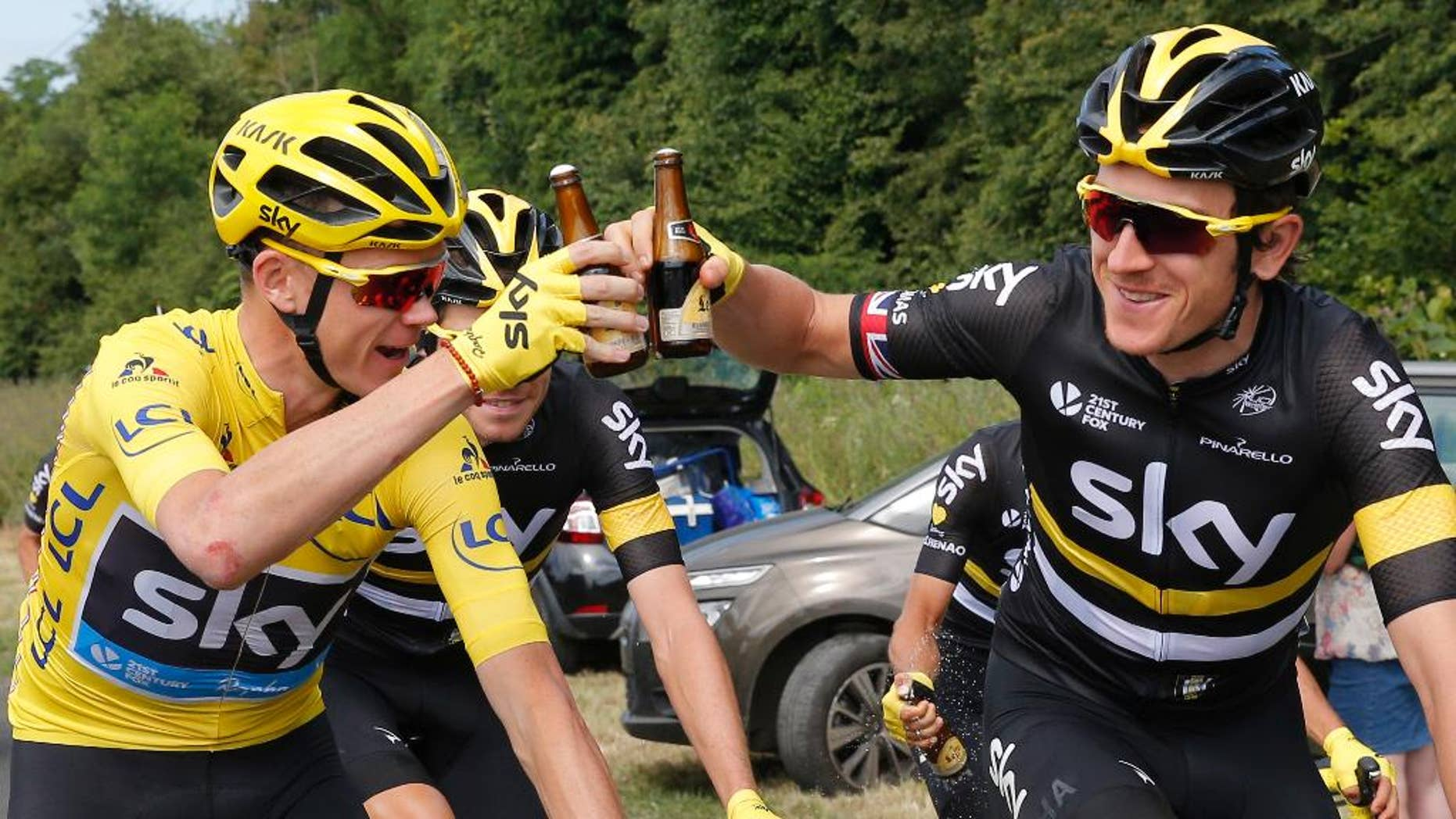 Britain's Chris Froome, wearing the overall leader's yellow jersey, and his Sky teammate Geraint Thomas.