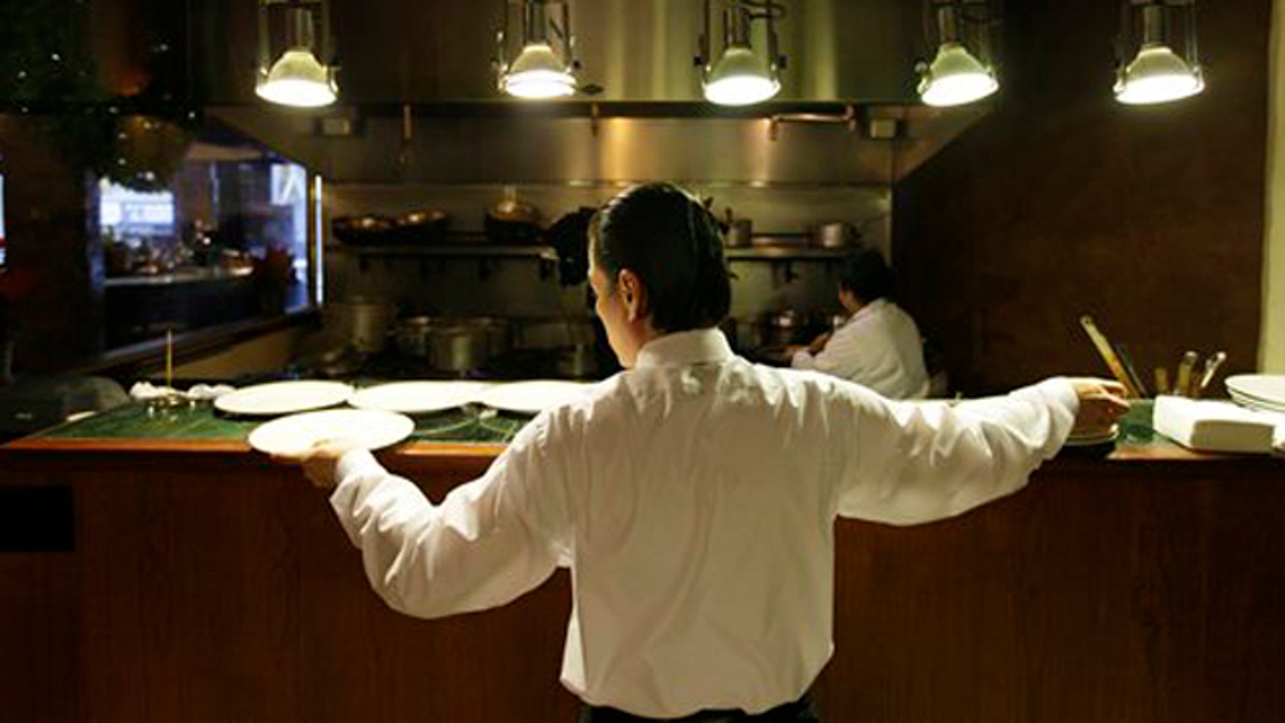 December 7, 2011: Workers prepare for lunch in the kitchen at the Palio D'Asti restaurant in San Francisco.