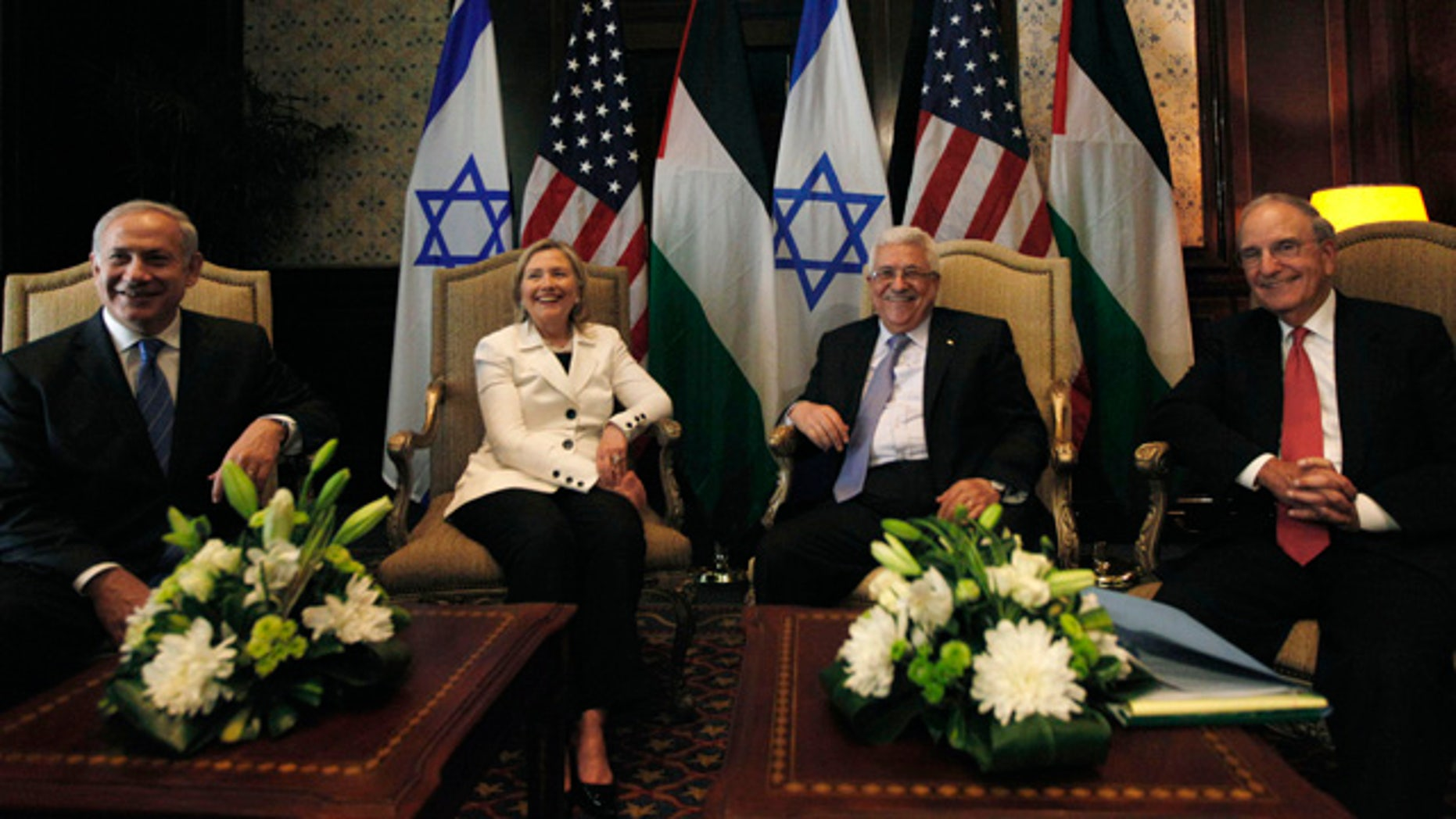 Sept. 14: From left, Israeli prime minister Benjamin Netanyahu, U.S. secretary of state Hillary Rodham Clinton, Palestinian president Mahmoud Abbas and U.S. Middle East envoy George Mitchell attend the bilateral talks at the Red Sea resort of Sharm el-Sheikh, Egypt.