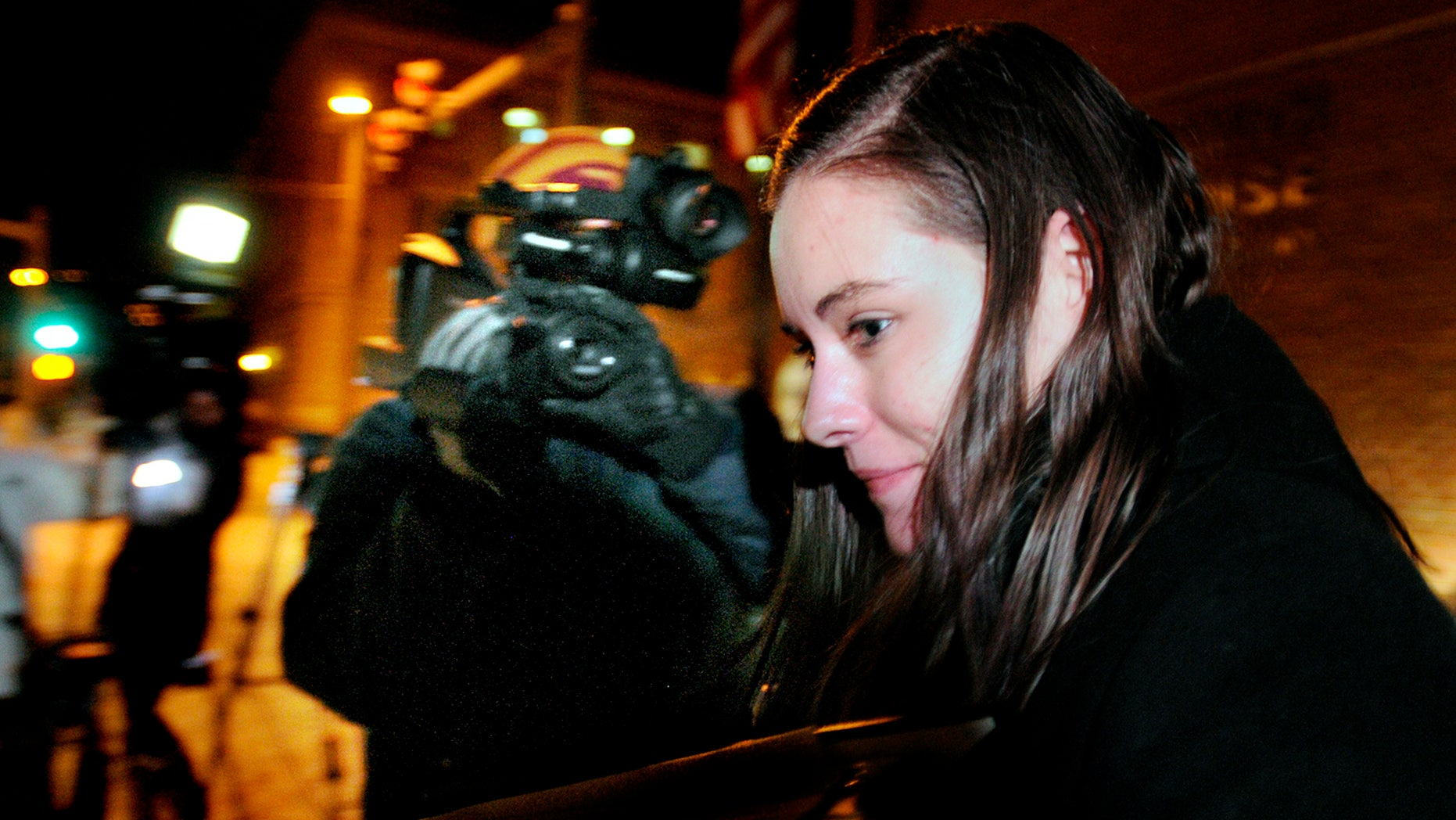 Jordan Graham leaves the Federal Courthouse in Missoula, Mont., Monday, Dec. 9, 2013 after the first day of her murder trial. Graham, 22, is accused of murdering Cody Johnson, her husband of eight days, by pushing him off a cliff in Glacier National Park on July 7. (AP Photo/Missoulian, Kurt Wilson)