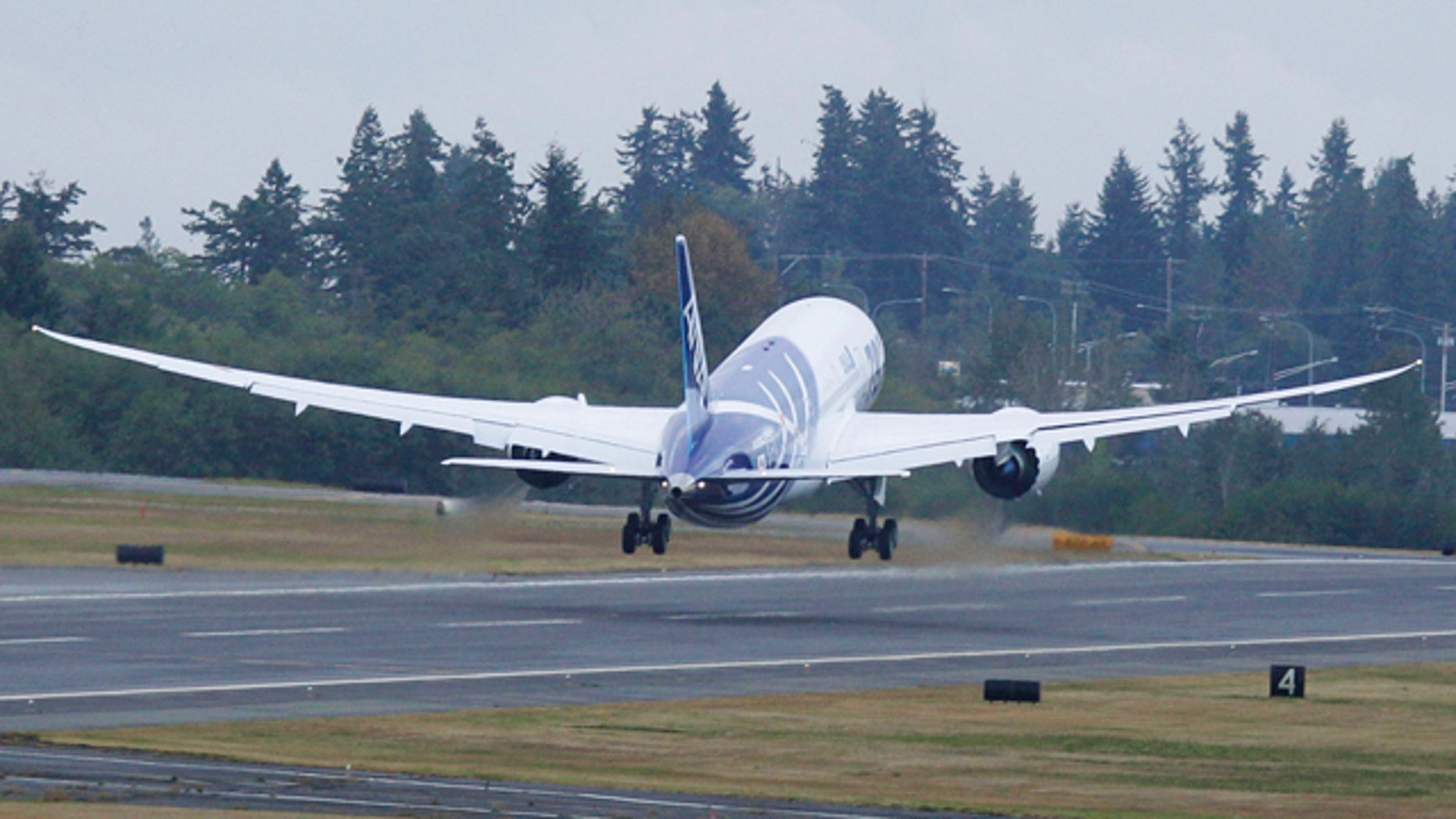 The first Boeing Co. 787 plane delivered to a commercial customer takes off for Japan, Tuesday, Sept. 27, 2011, in Everett, Wash. The plane will be operated by Japan's All Nippon Airways.