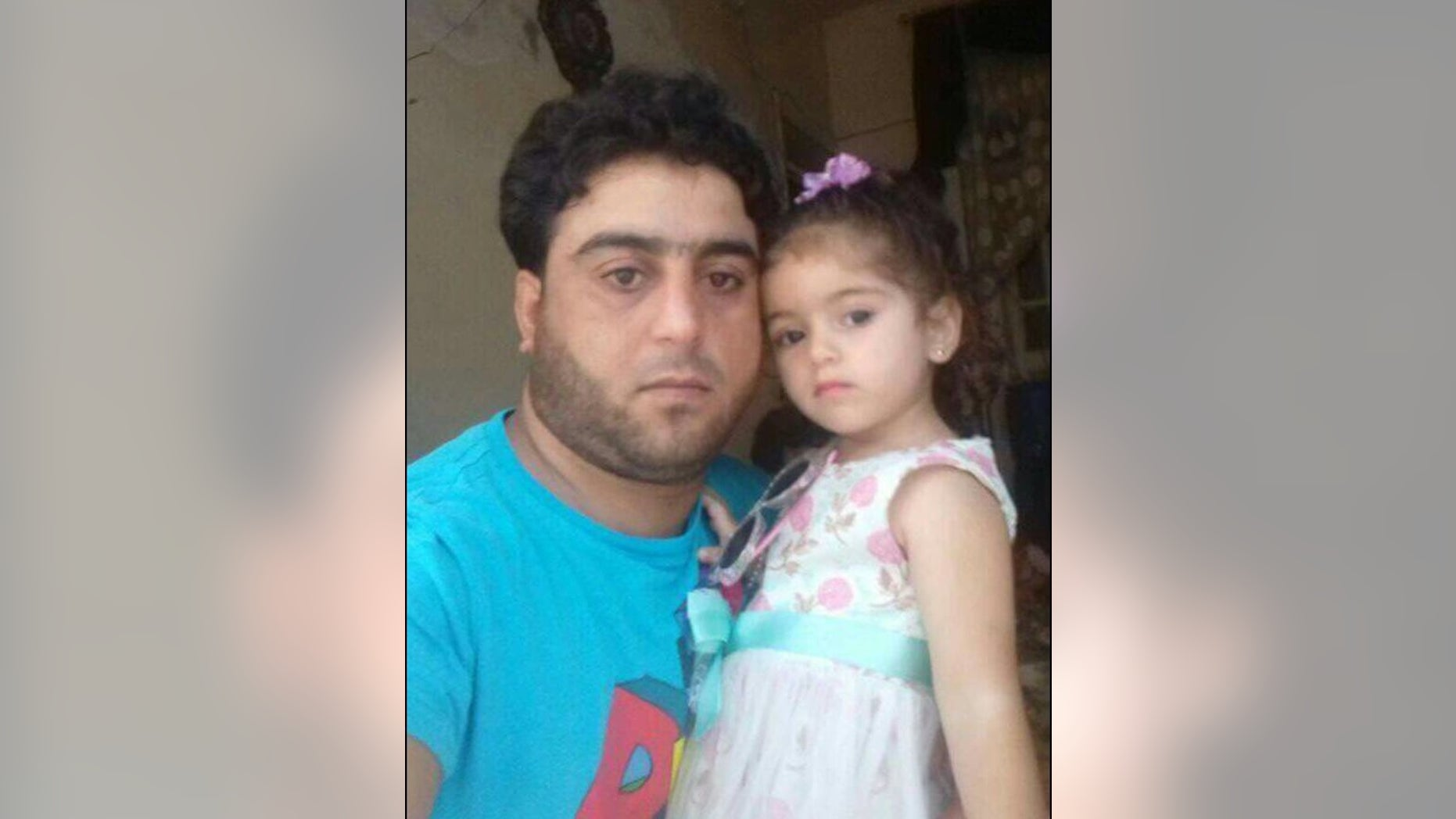 Ghazwan, a Syrian amputee in the rebel-held stronghold of Idlib, pictured with his daughter. He is trying to sell his prosthetic foot to pay back loans and support his family.