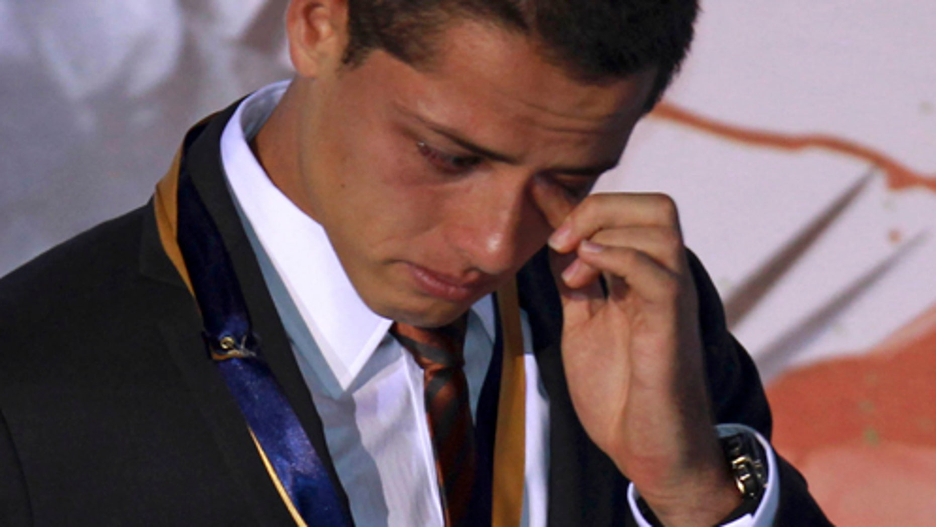 """July 21: Mexican soccer player Javier """"Chicharito"""" Hernandez, reacts during a ceremony in which he was named the 2011 Tourism Ambassador for the State of Jalisco in Guadalajara, Mexico. Chicharito currently plays for the  English football club Manchester United. (AP Photo/Bruno Gonzalez)"""