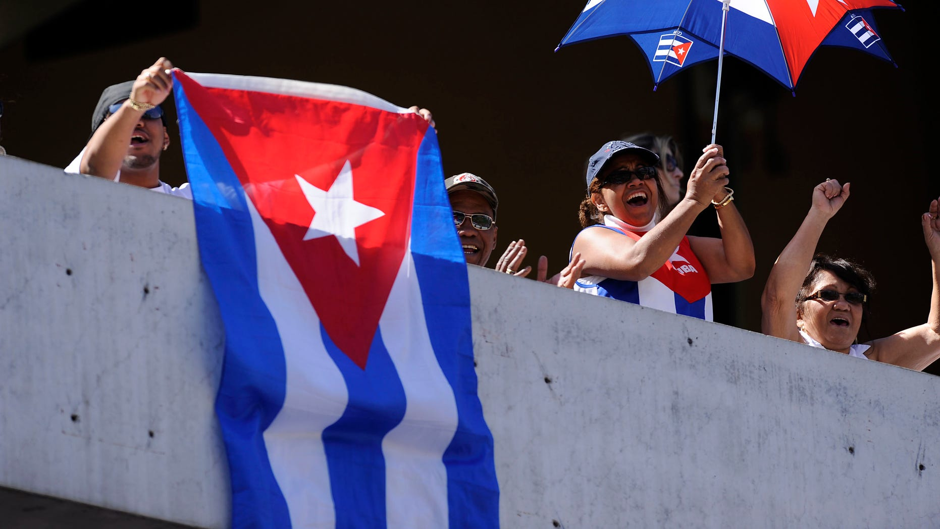 SAN DIEGO - MARCH 15: Fans od Cuba cheer for their team as they play against Japan during the 2009 World Baseball Classic Round 2 Pool 1 match on March 15, 2009 at Petco Park in San Diego, California.  (Photo by Kevork Djansezian/Getty Images)