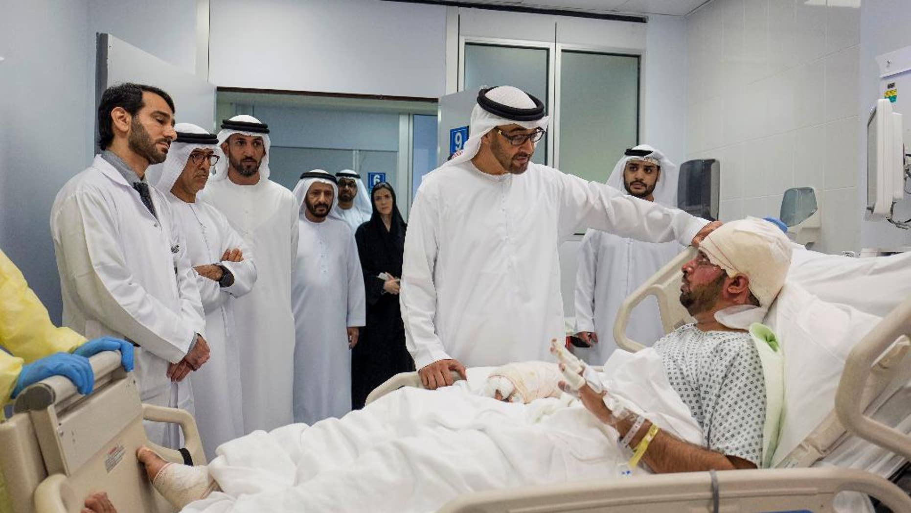 FILE- In this Saturday, Jan. 14, 2017, file photo released by Emirates News Agency, WAM, Sheikh Mohamed bin Zayed Al Nahyan Crown Prince of Abu Dhabi and Deputy Supreme Commander of the UAE Armed Forces, visits Juma Al Kaabi, the UAE Ambassador to Afghanistan, who was injured in the Kandahar terrorist attack at Al Mafraq hospital in Abu Dhabi, United Arab Emirates. The United Arab Emirates says its ambassador to Afghanistan has died after sustaining injuries in the January bombing that claimed the lives of five of his compatriots.(Crown Prince Court via AP)