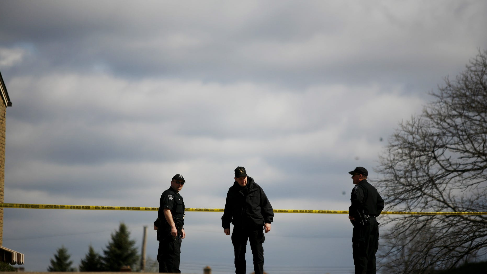 PITTSBURGH - APRIL 4:  Pittsburgh Police officers watch over the crime scene from a nearby corner April 4, 2009 in Pittsburgh, Pennsylvania. Five police officers were shot during a standoff with a suspect in the Stanton Heights neighborhood of Pittsburgh, after police responded to a domestic dispute.  (Photo by Ross Mantle/Getty Images)