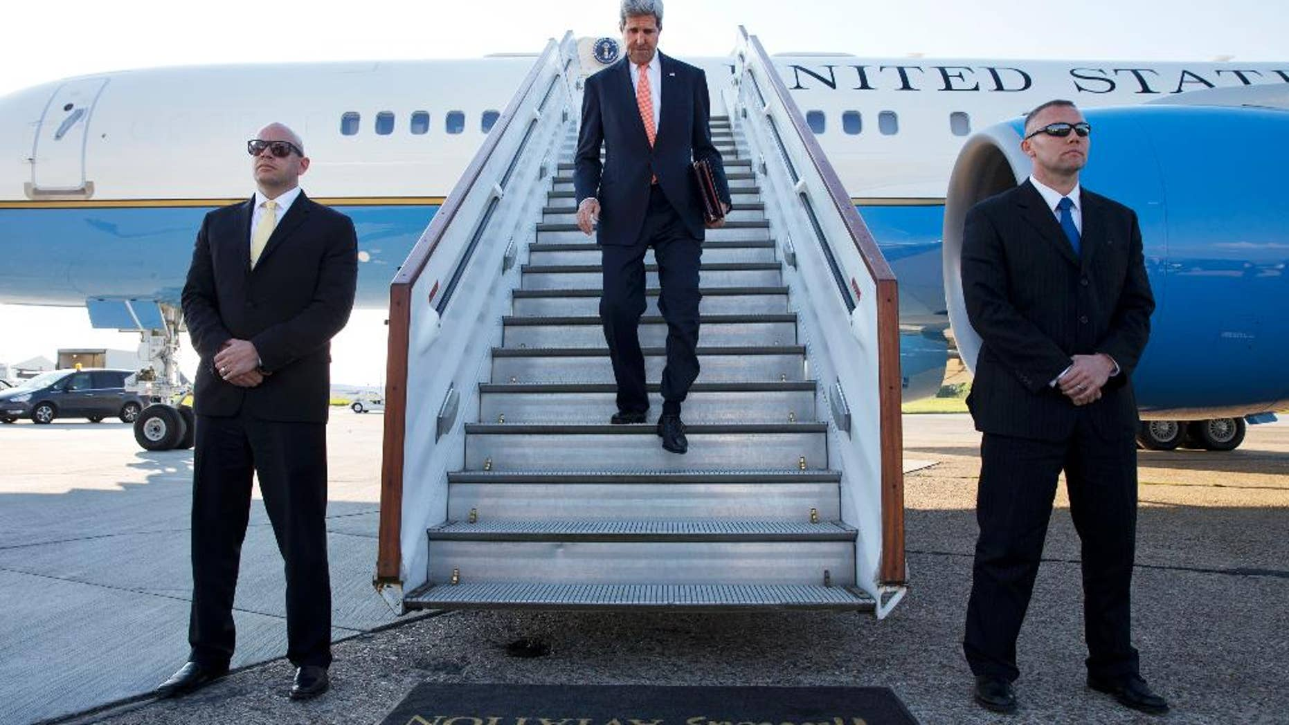 U.S. Secretary of State John Kerry arrives at Stansted Airport outside of London, where he is expected to attend meetings on Syria with the London 11, Wednesday, May 14, 2014. (AP Photo/Jacquelyn Martin, Pool)