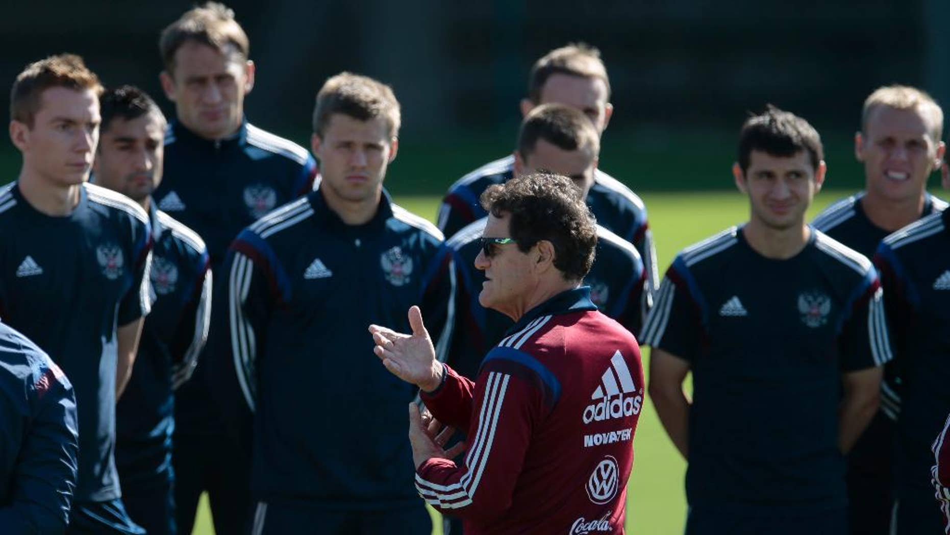 Fabio Capello, Italian coach of Russian national soccer team, center, speaks to his players during a training session in Itu, Brazil, on Thursday, June 19, 2014. Russia will play next game against Belgium in group H of the 2014 soccer World Cup. (AP Photo/Ivan Sekretarev)