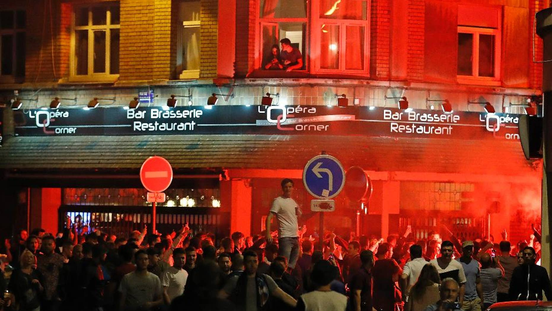 England supporters gather outside a bar in downtown Lille, France Wednesday, June 15, 2016 one day ahead of the Euro 2016 Group B soccer match against Wales in nearby Lens.