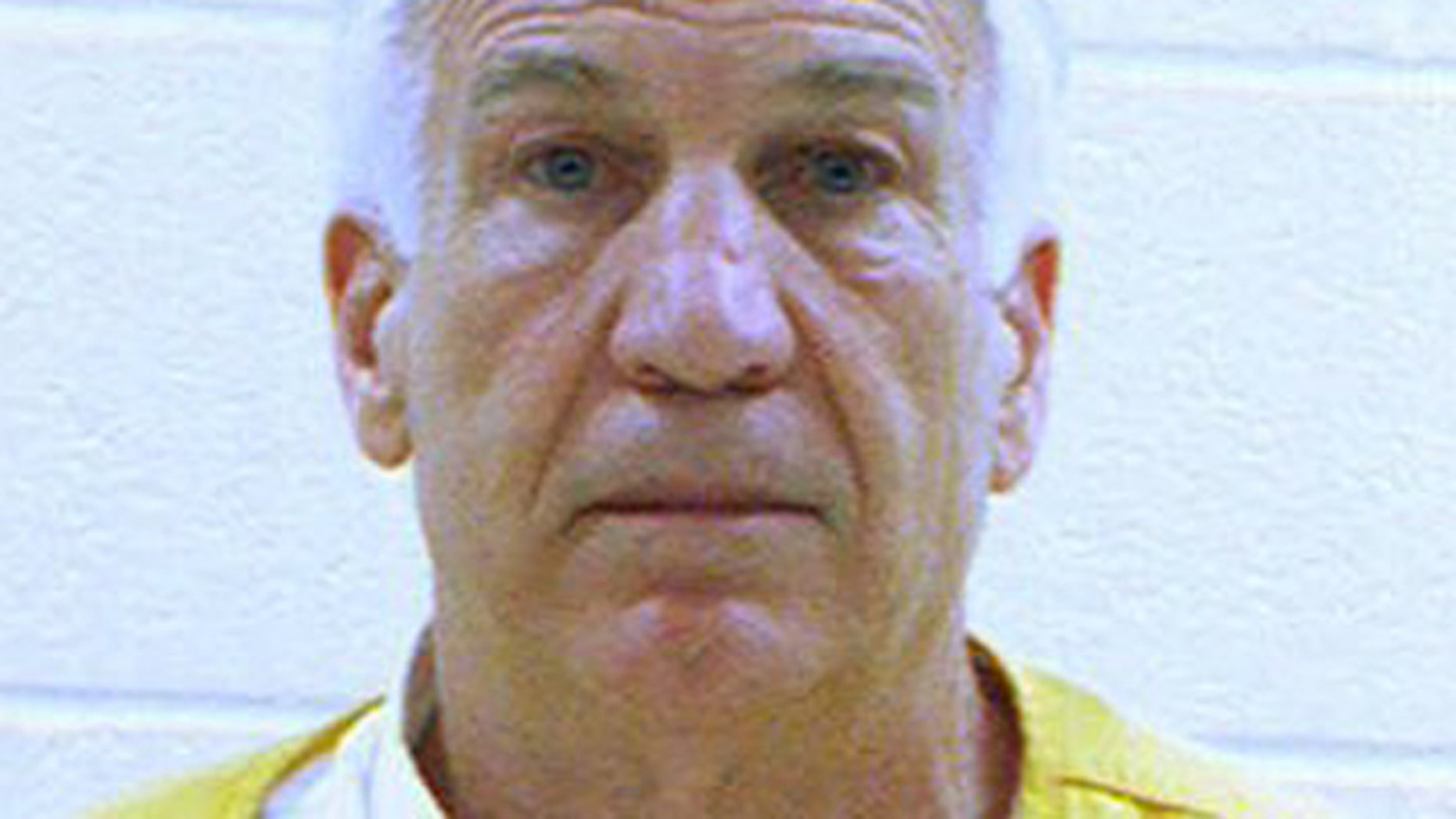 June 23, 2012: Former Penn State University assistant football coach Jerry Sandusky is shown in a booking photo. (AP/Centre County Correctional Facility)