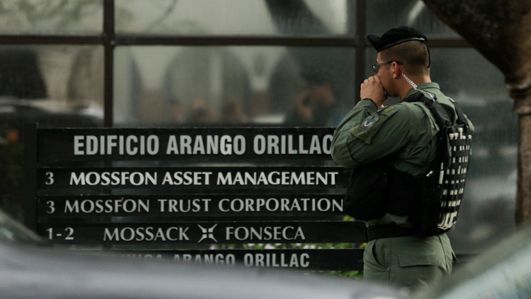 A police officer stands outside Mossack Fonseca law firm in Panama City, Tuesday, April 12, 2016.