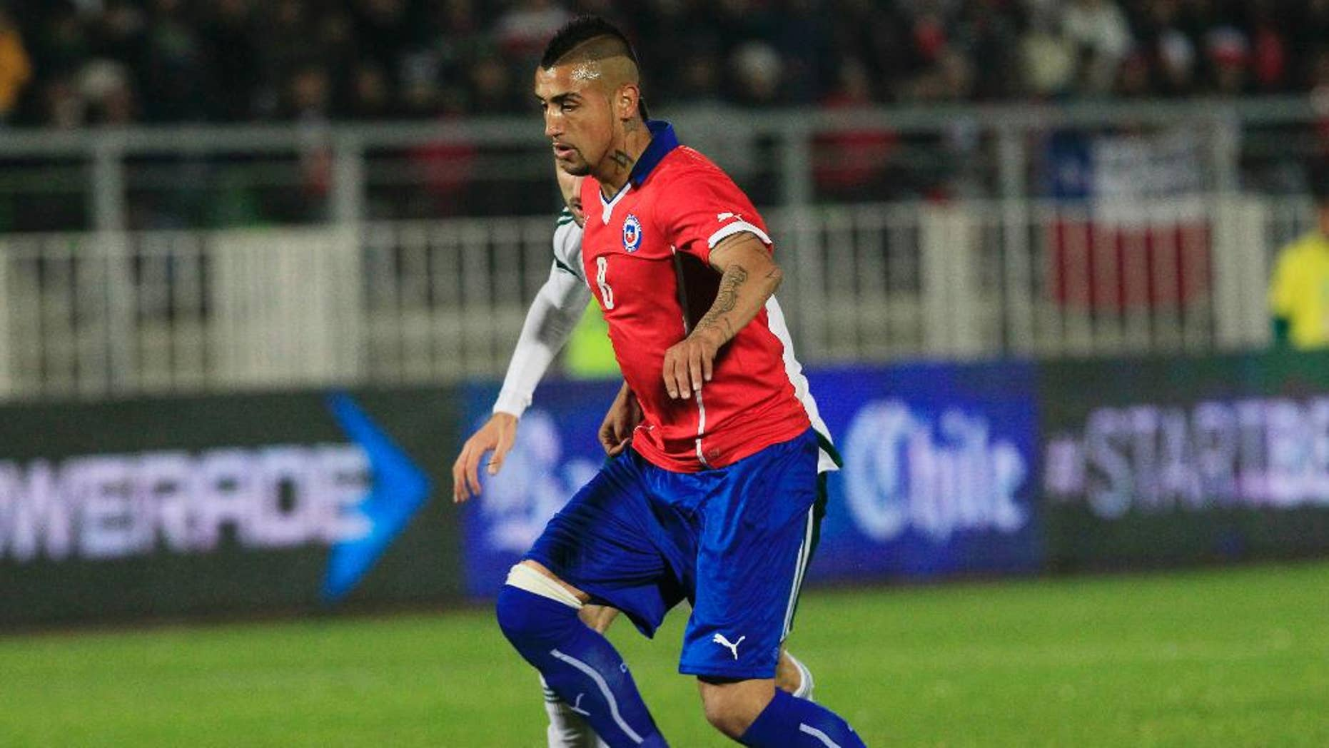 Chile's Jose Rojas, battles for the ball during an international friendly soccer match against Northern Ireland, in Valparaiso, Chile, Wednesday, June 4, 2014. (AP Photo/Luis Hidalgo)